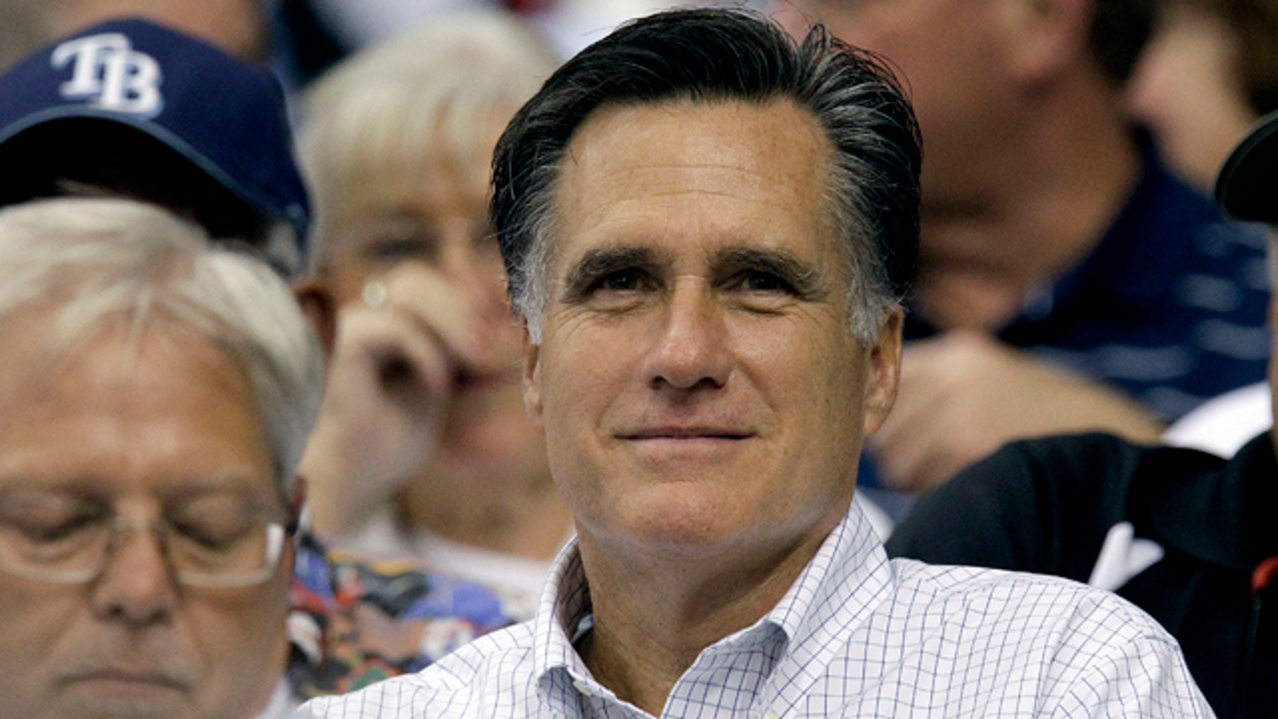 June 15: GOP hopeful Mitt Romney watches a baseball game between the Tampa Bay Rays and the Boston Red Sox. Perhaps there's no better evidence of his frontrunner status than the attacks leveled against his abortion stance by fellow candidates.