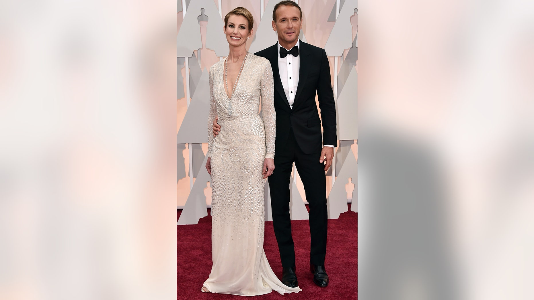 Faith Hill, left, and Tim McGraw arrive at the Oscars on Sunday, Feb. 22, 2015, at the Dolby Theatre in Los Angeles.