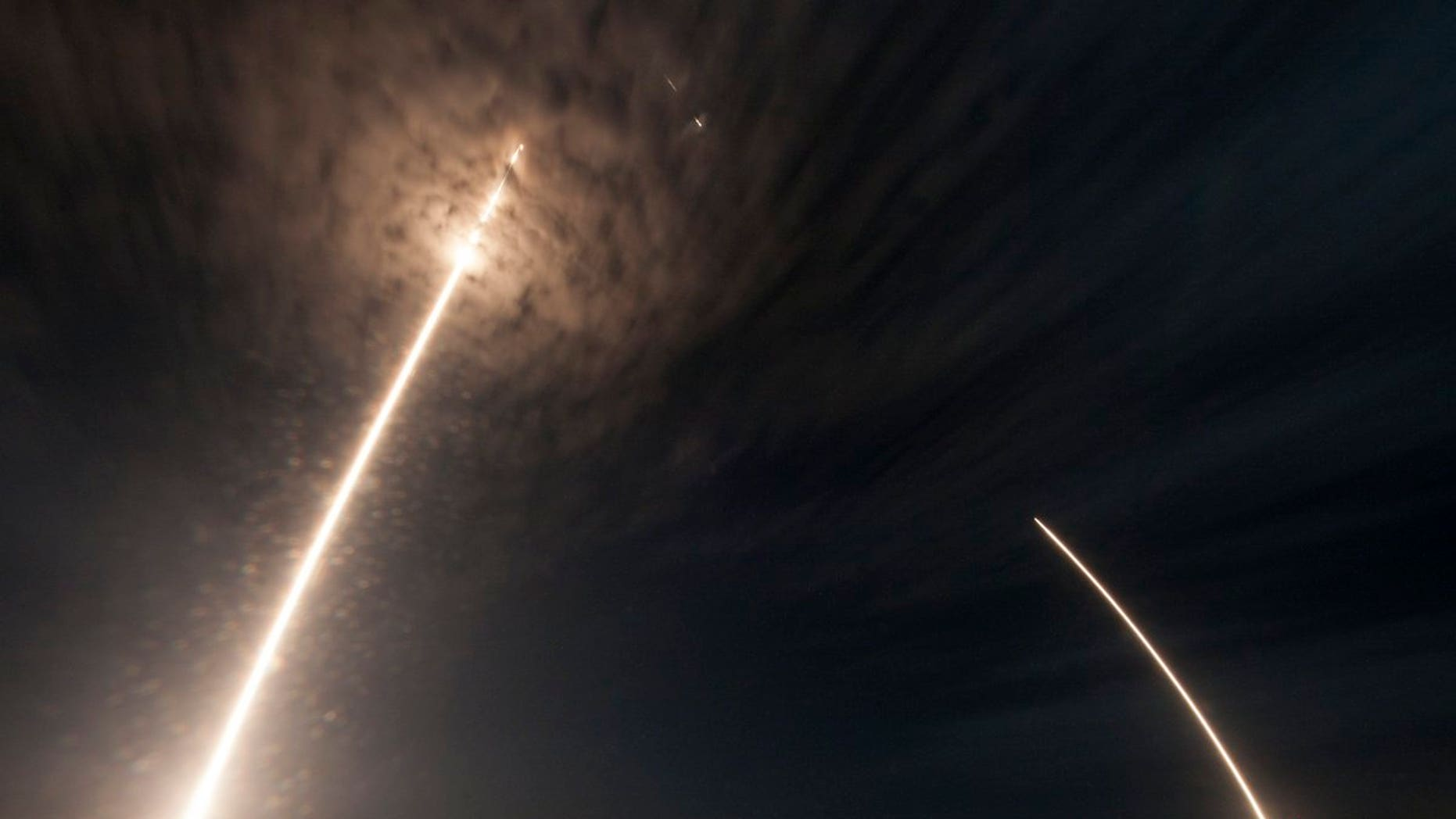 Composite image showing SpaceX's Falcon 9 rocket lifting off, and then landing at, Florida's Cape Canaveral Air Force Station on July 18, 2016.