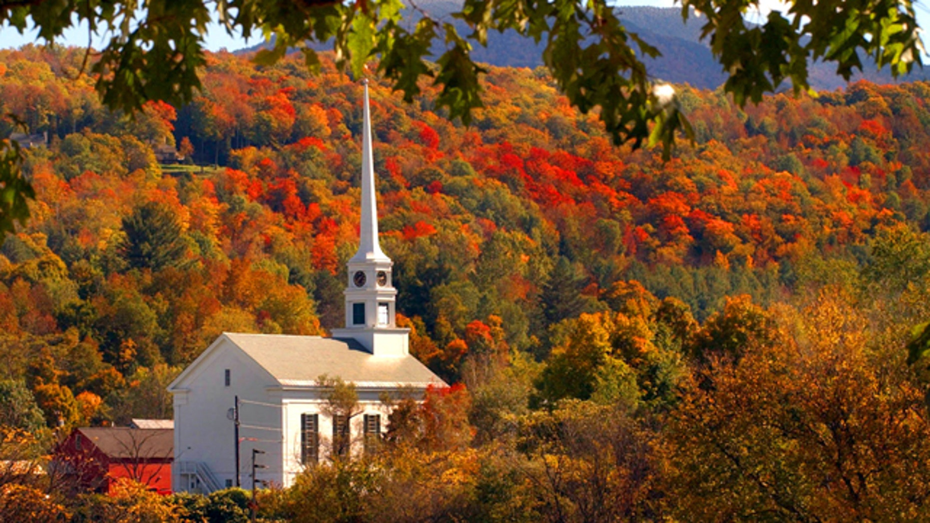 The early fall foliage frames the Stowe Community Church in Stowe, Vt., Tuesday, Oct. 5, 2004.