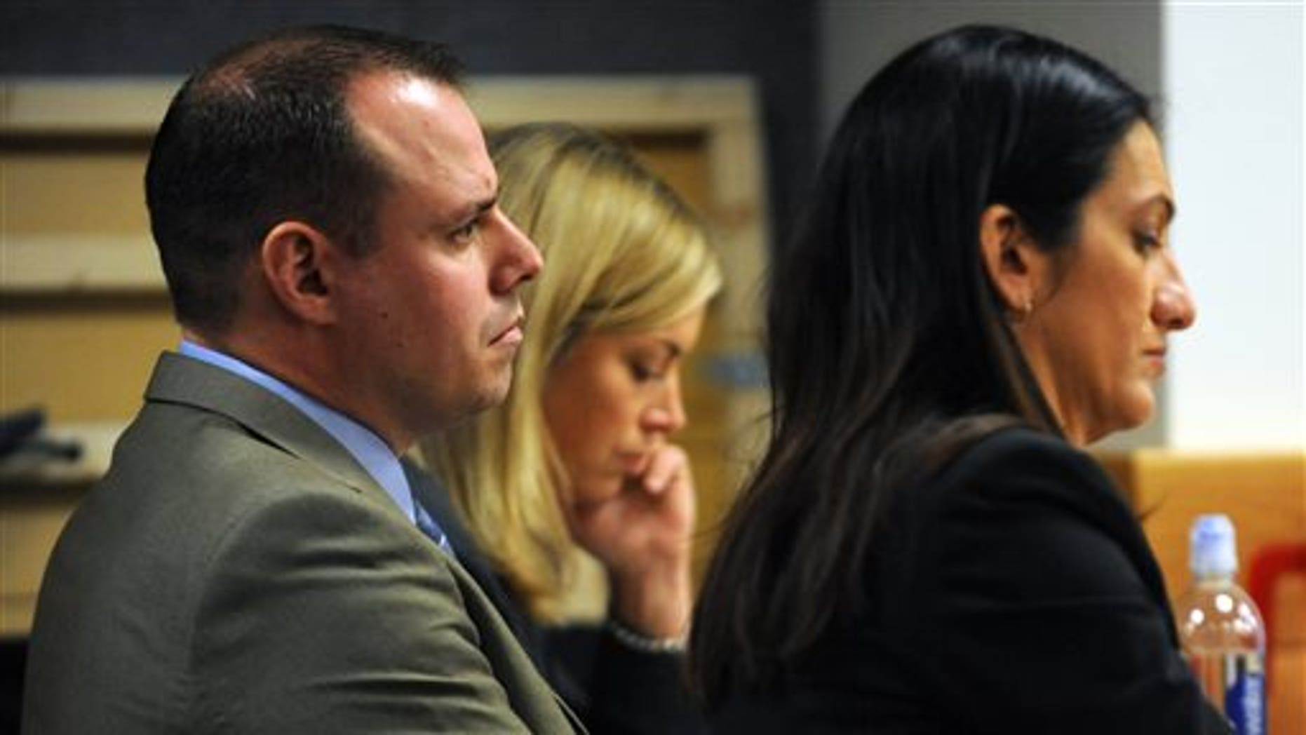 Tom Fallis watches opening statements on March 16.