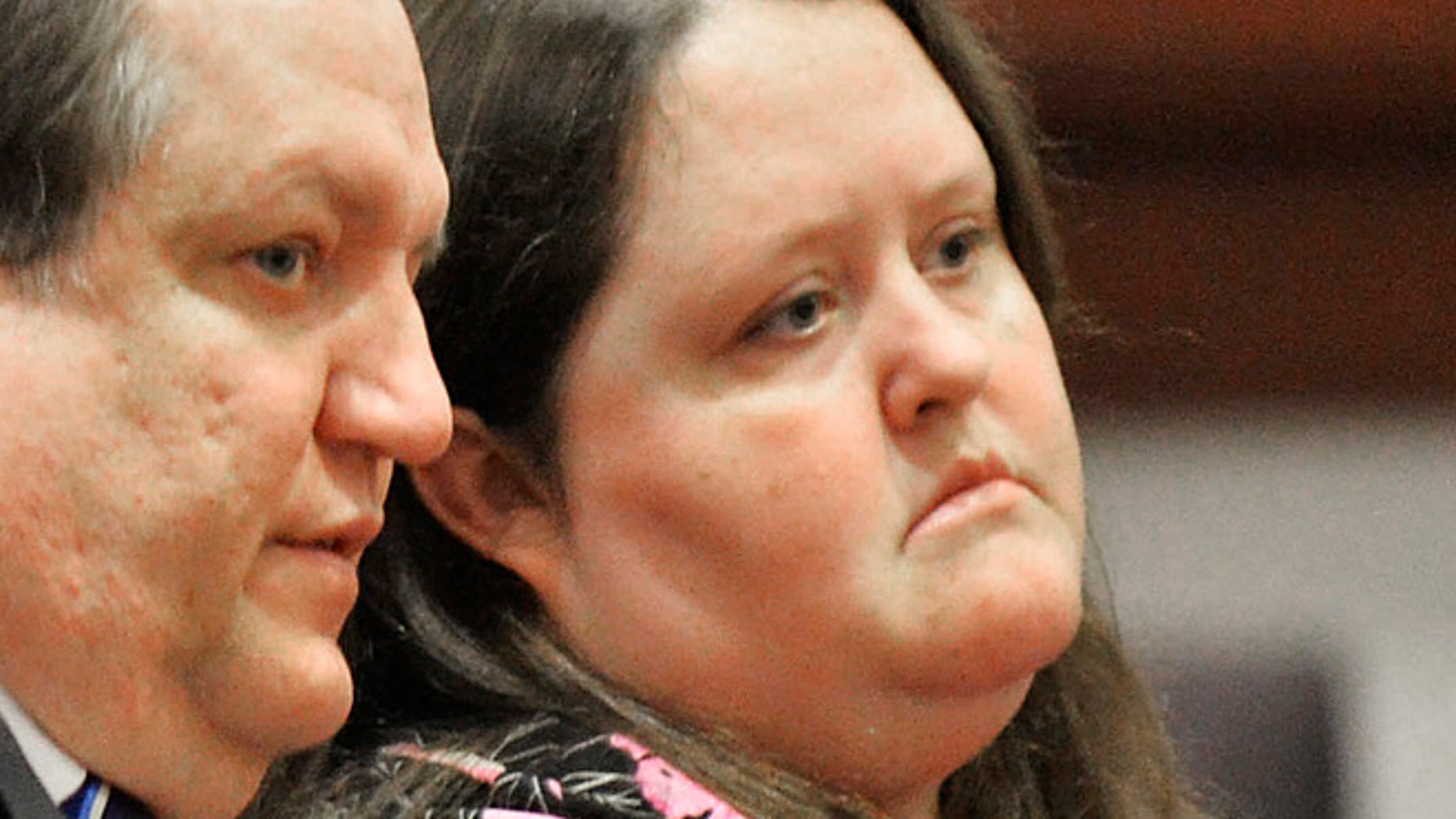 April 15, 2014: In this photo, Rachael Michelle Rapraeger, right, sits with her attorney, Floyd Buford, during a sentencing hearing.
