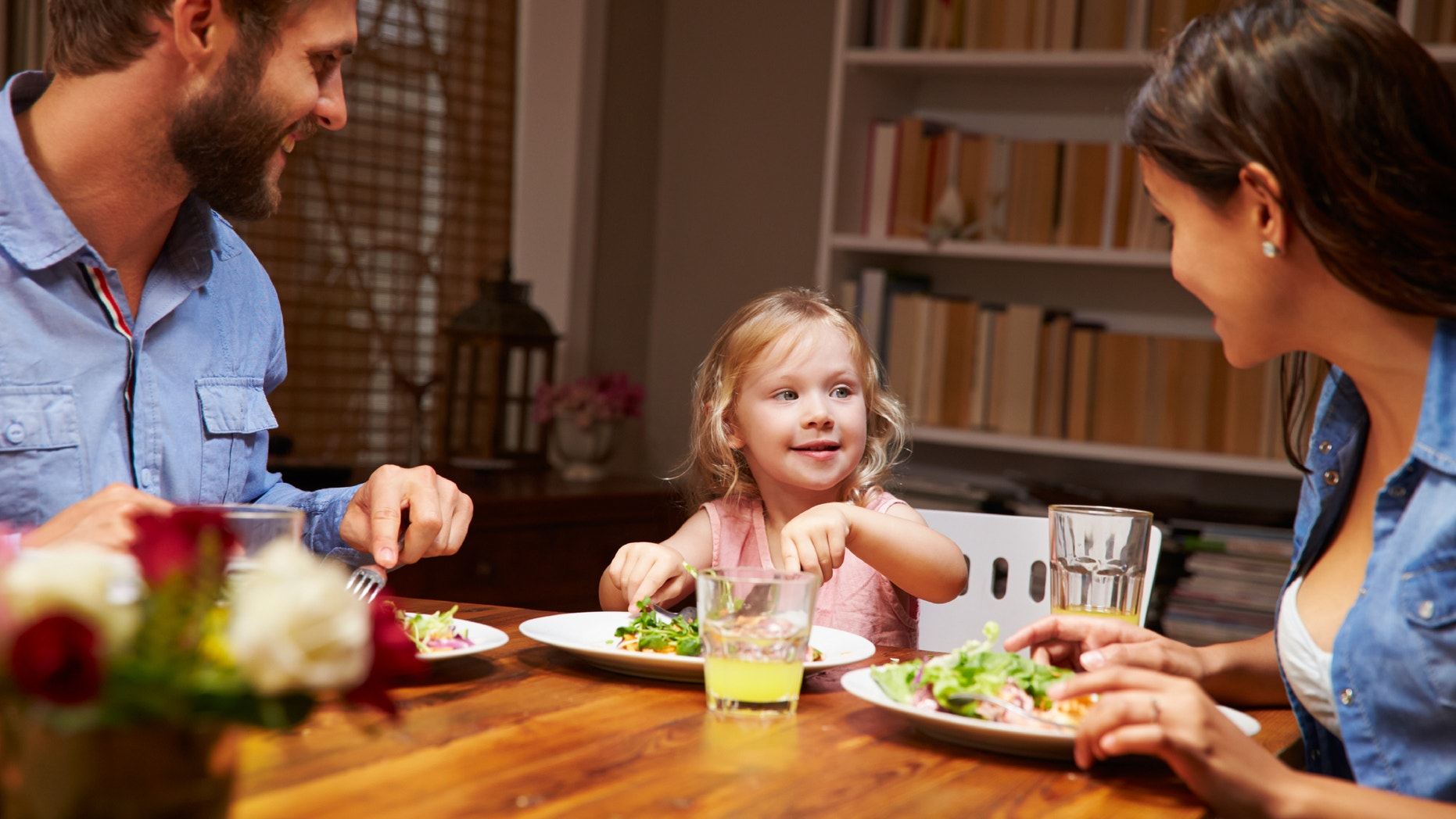 Family eating dinner at a dining table