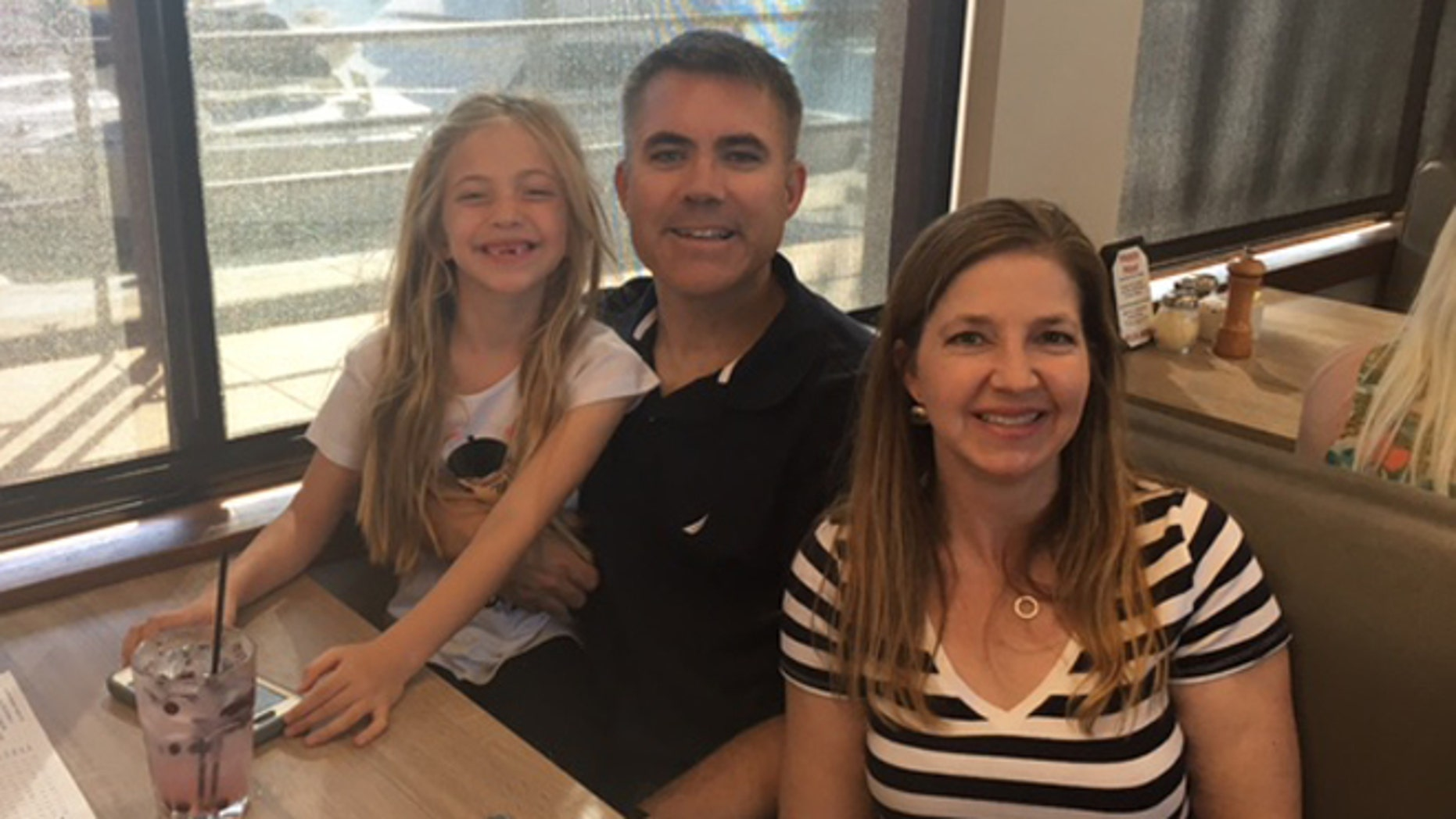Christian Heller, flanked by daughter Audrey and wife Rachel, is grateful for Audrey's piano lessons provided by Our Military Kids.