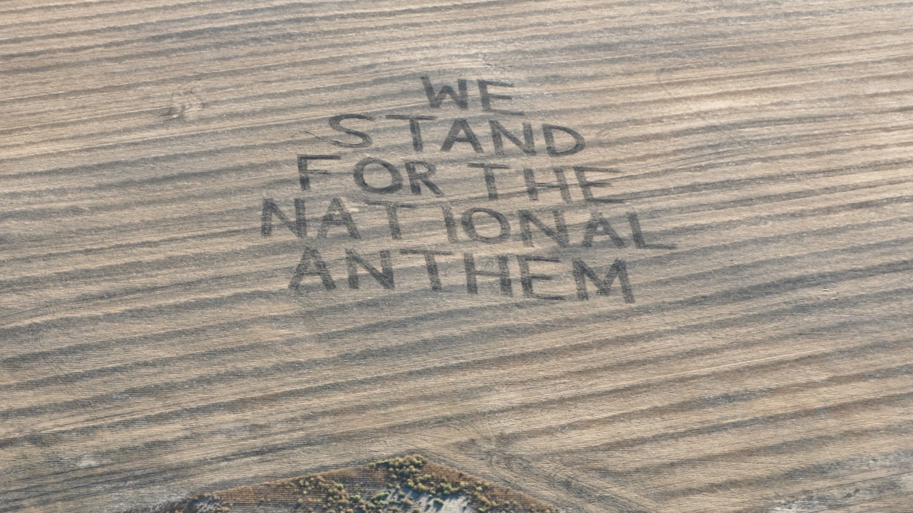 """Farmer Gene Hanson plowed a message for the NFL -- """"We Stand for the National Anthem"""" -- into his field in North Dakota."""