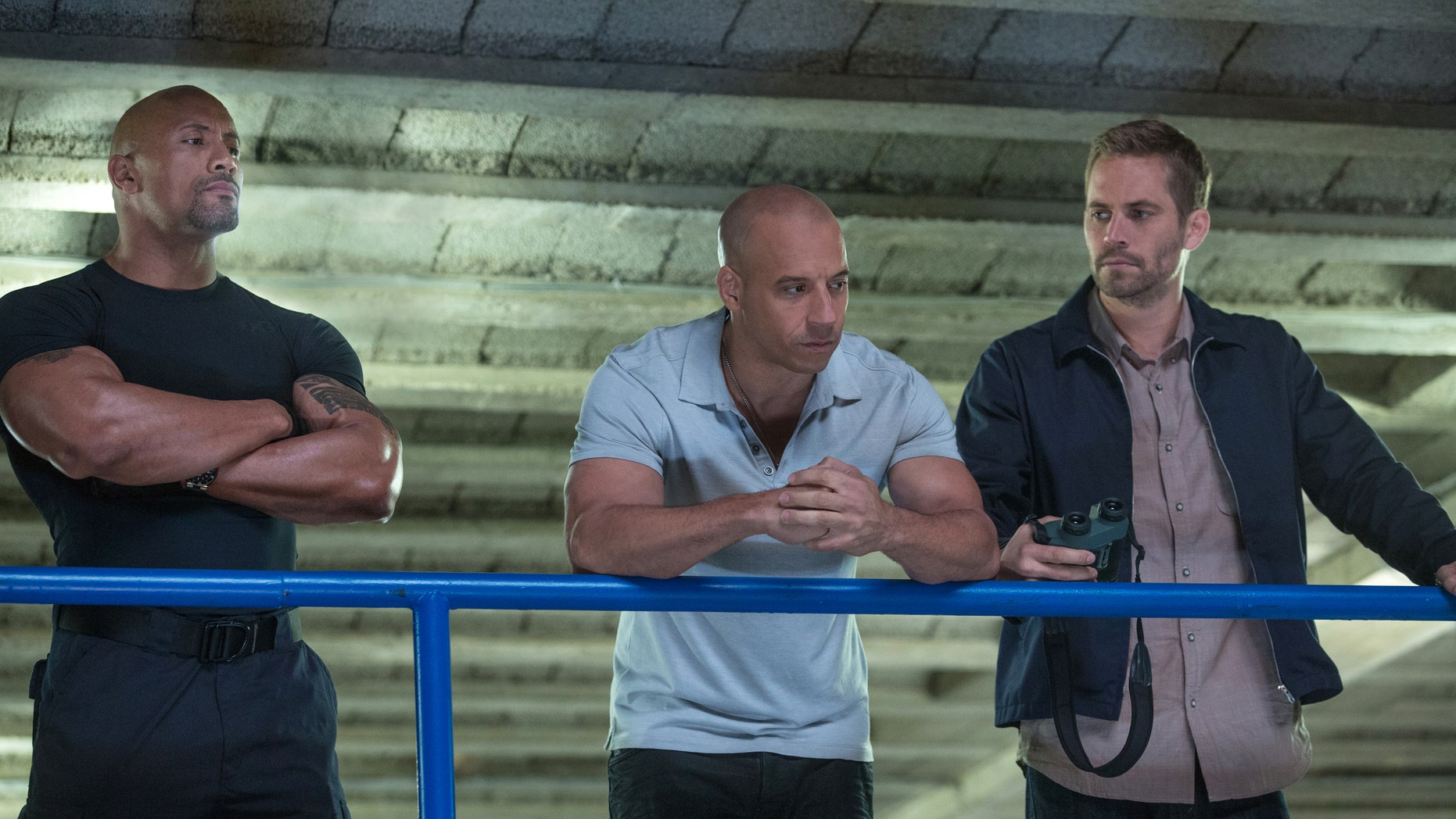 """This film publicity image released by Universal Pictures shows Dwayne Johnson , left, Vin Diesel, center, and Paul Walker in a scene from """"Fast & Furious 6."""" (AP Photo/Universal Pictures, Giles Keyte)"""