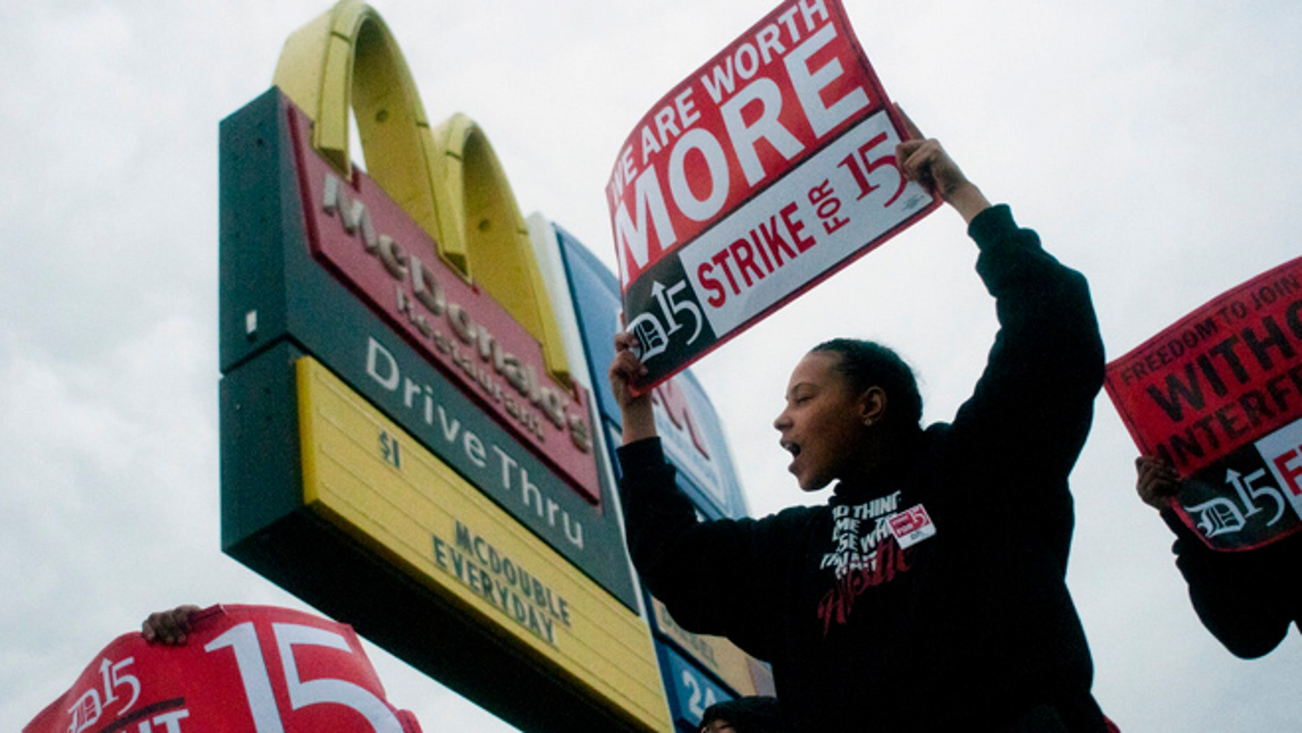 July 31, 2013: Fast-food worker Michelle Osborn, 23, of Flint, Mich. shouts out chants as she and a few dozen others strike outside of a McDonald's restaurant in Flint. A few thousand fast-food workers in seven cities took to the streets demanding better pay, the right to unionize and a more than doubling of the federal minimum hourly wage from $7.25 to $15.