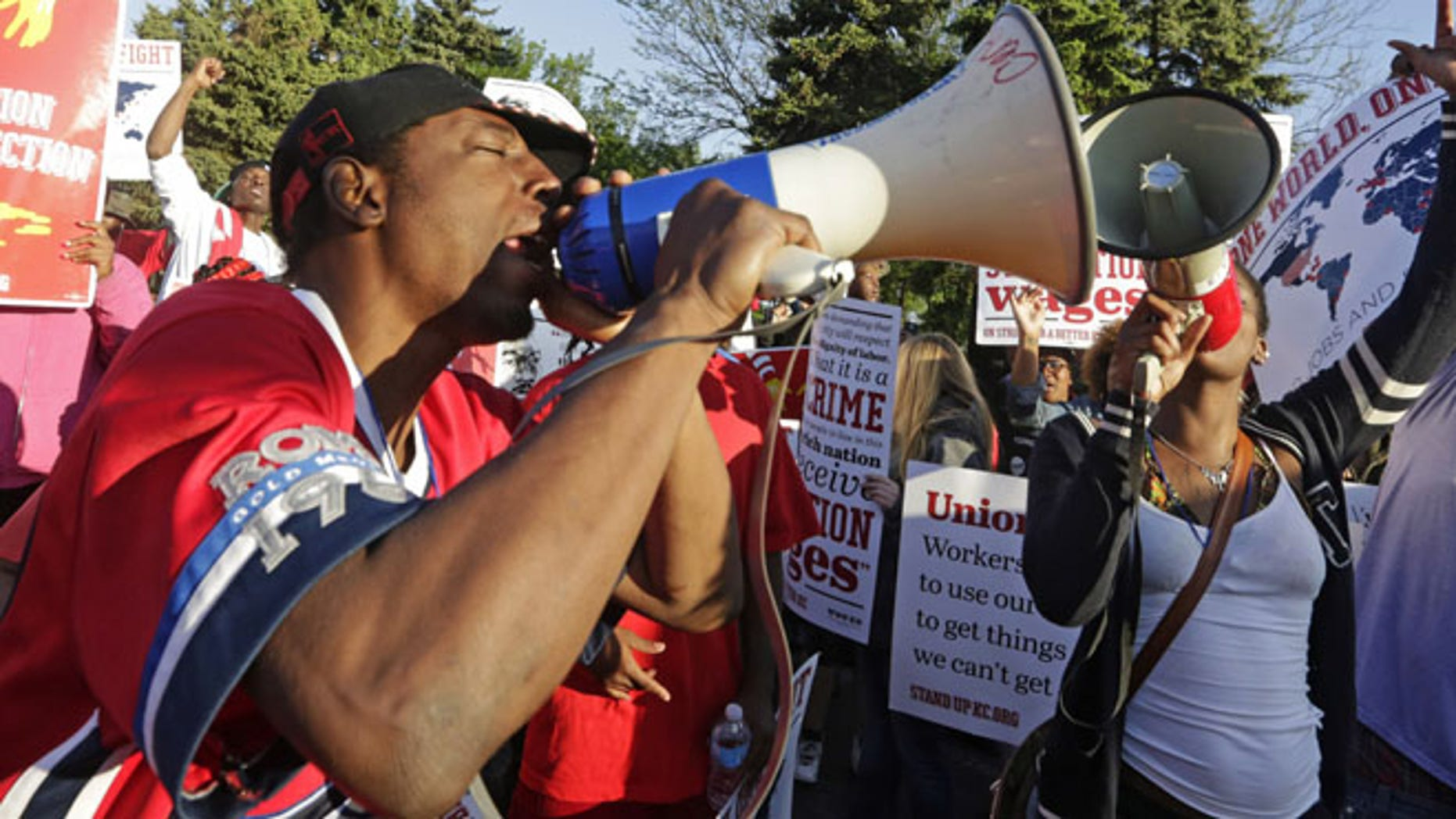 May 22, 2014: Protesters gather outside of the McDonald's Corporation headquarters in Oak Brook, Ill., the annual shareholders meeting demonstrating for higher wages and the right to unionize. (AP)