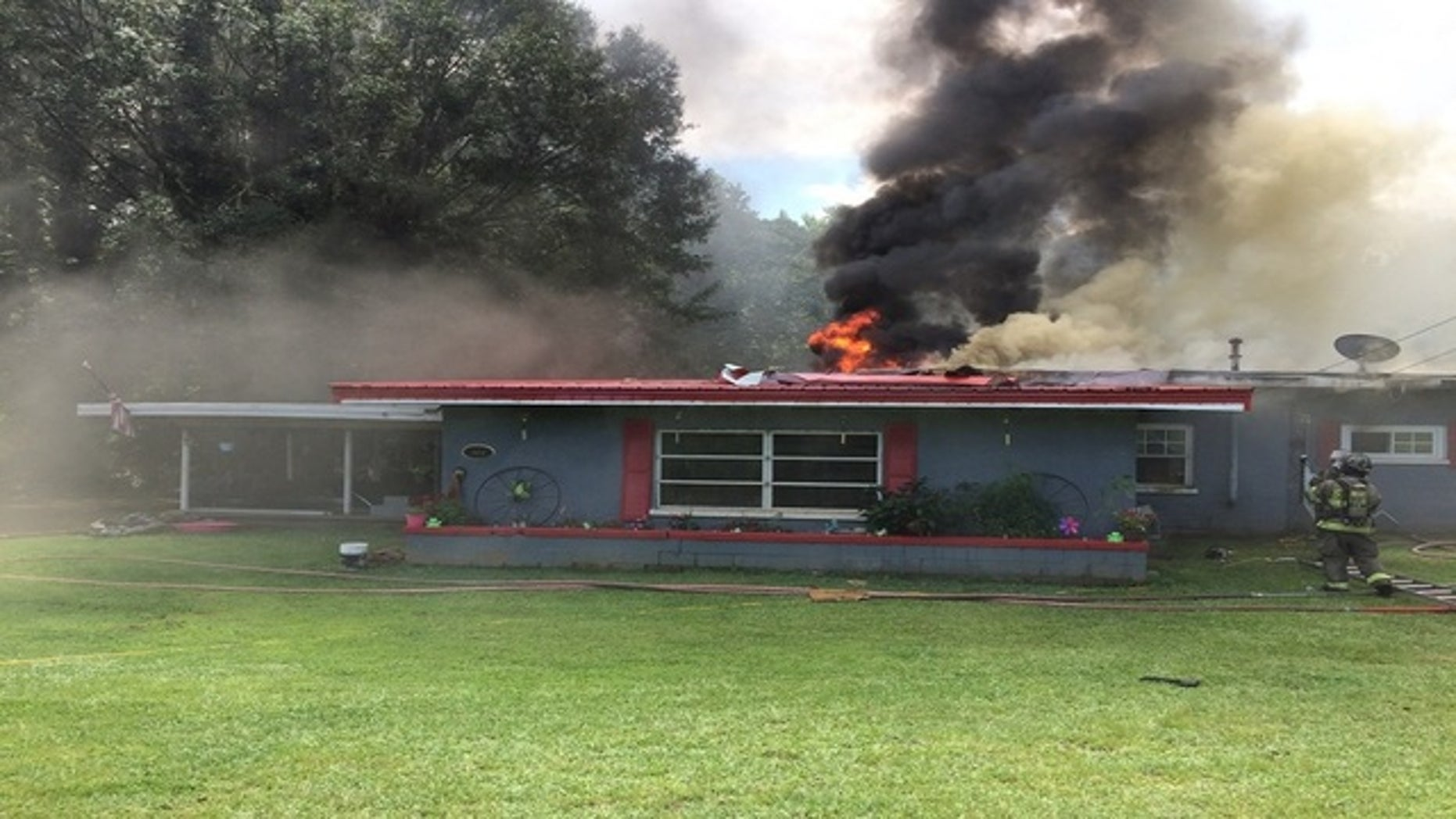 The deadly fire at a home in Spalding County, Georgia, on Saturday was caused by a cigarette tossed into a trash can, officials say. (Fox 5 Atlanta)