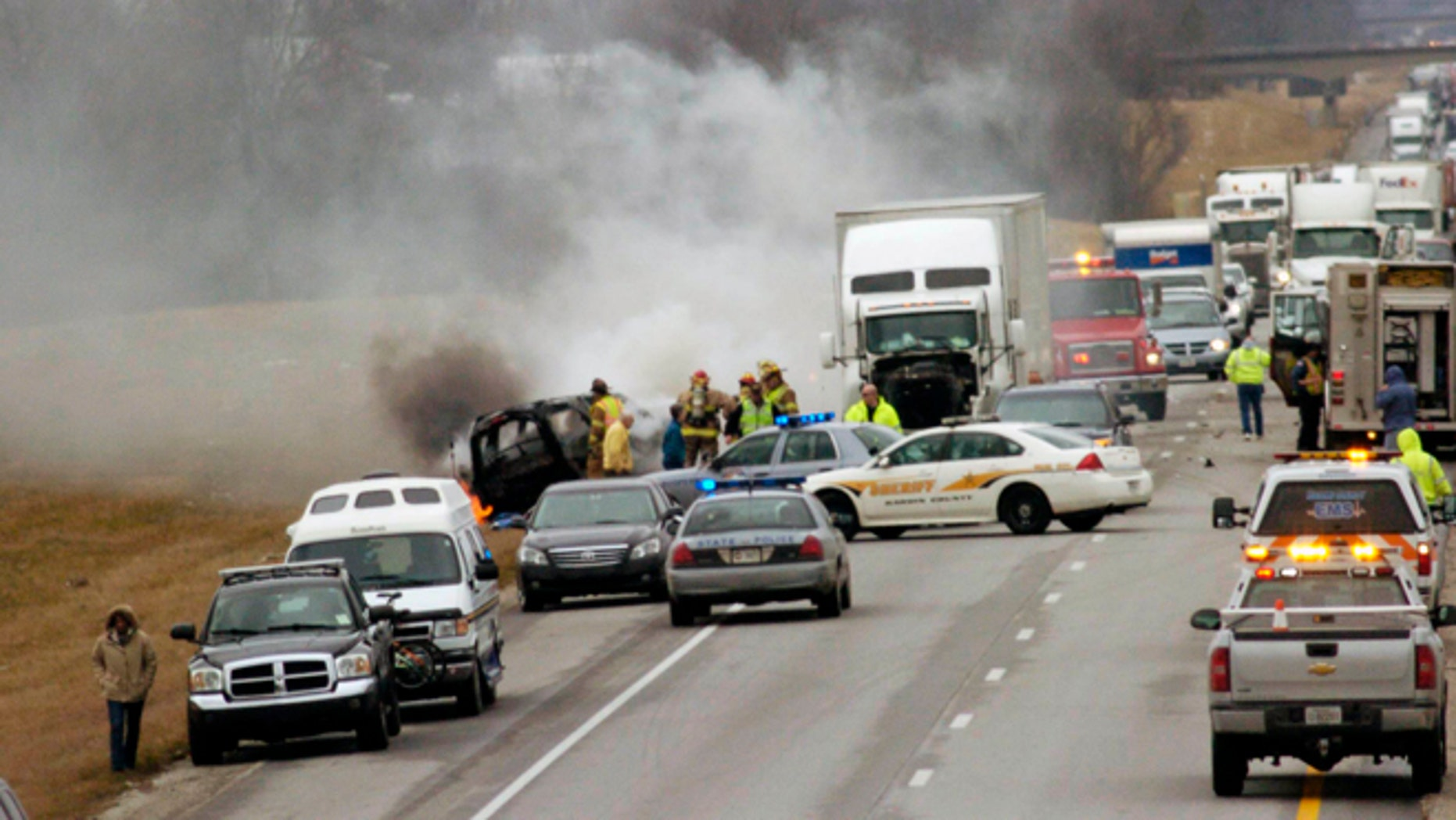 March 2, 2013: Emergency personnel work at the scene of a multi-vehicle wreck on Interstate 65 near the 82 mile marker north of Sonora, Ky.