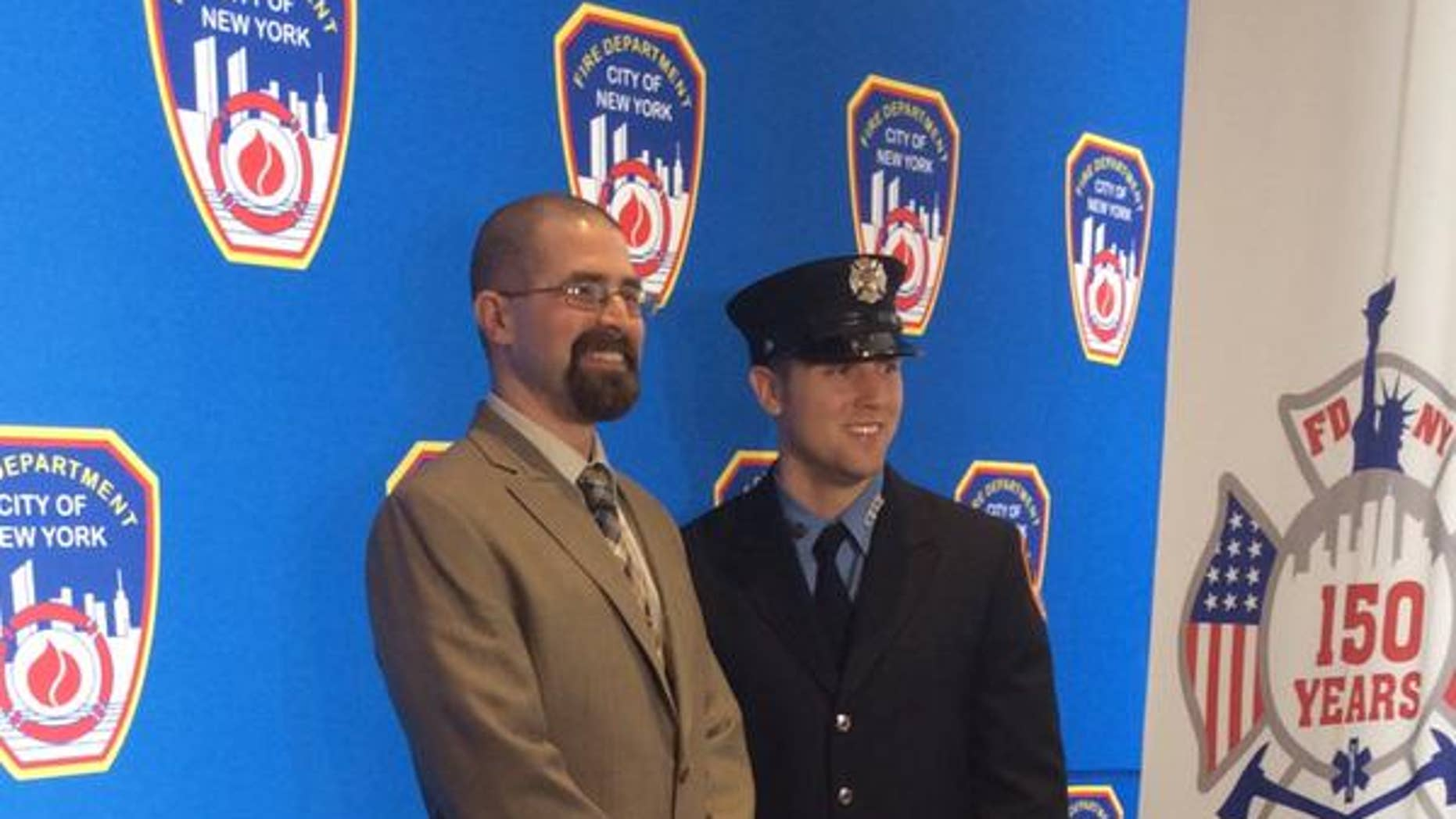 Former Marine Aaron Faulkner, left, meets FDNY firefighter Michael McCauley, right, who saved his life by donating bone marrow.