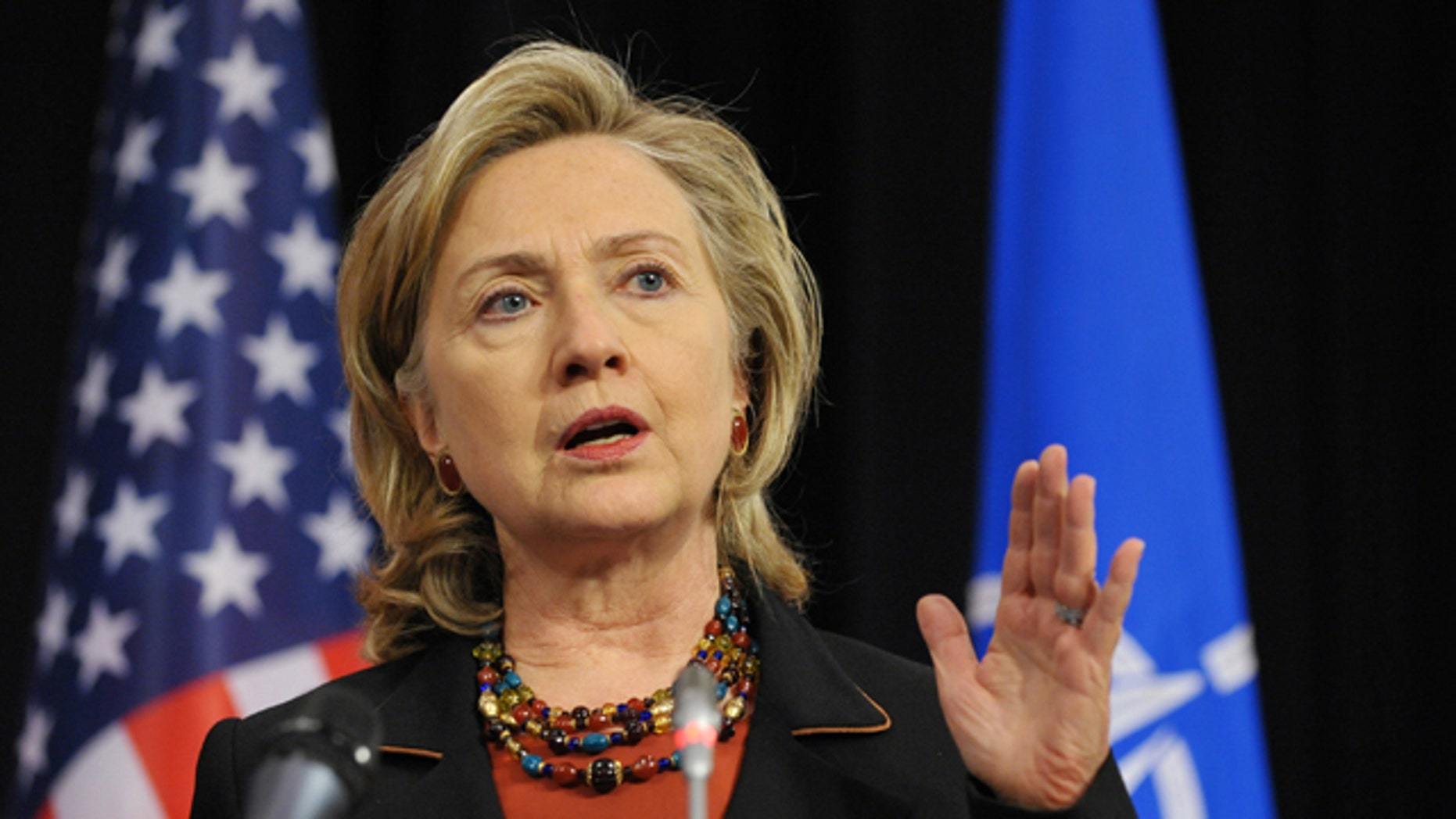 Oct. 14, 2010: US Secretary of State Hillary Clinton speaks during a joint press conference with Defense Secretary Robert Gates, at NATO Headquarters in Brussels.