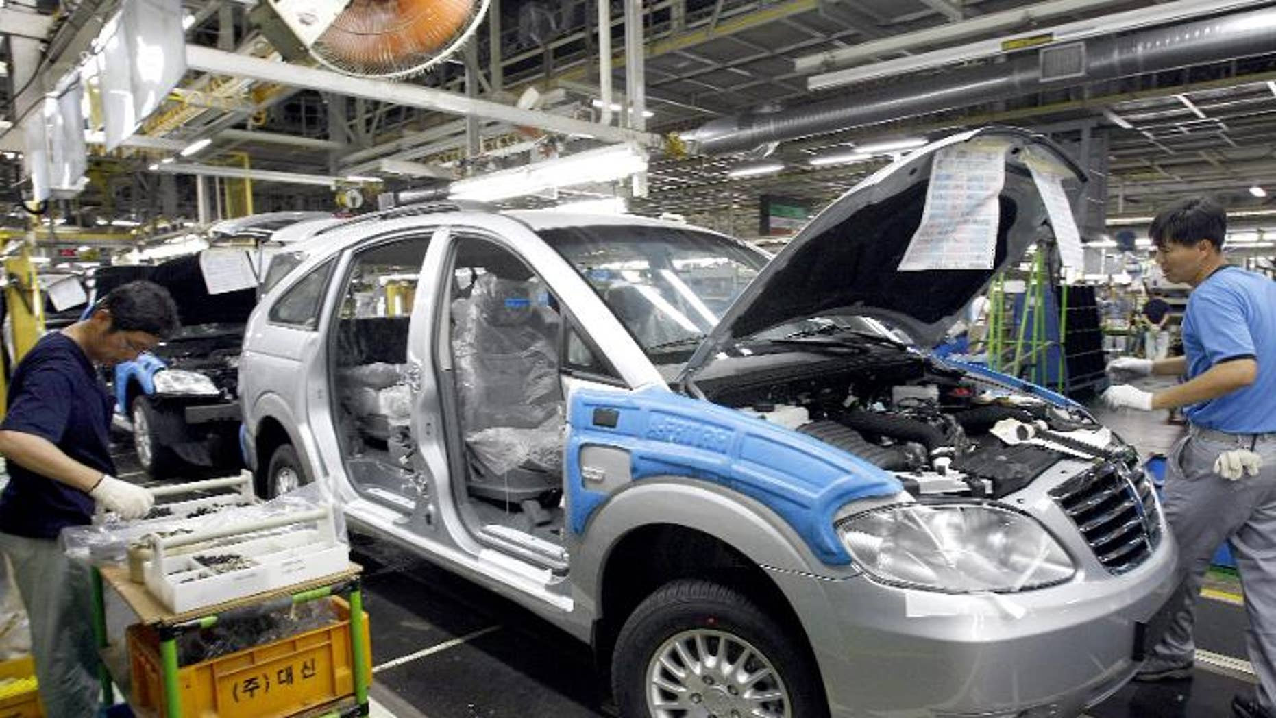 Illustration: Ssangyong Motor workers assemble cars on the production line in Pyeongtaek, South Korea