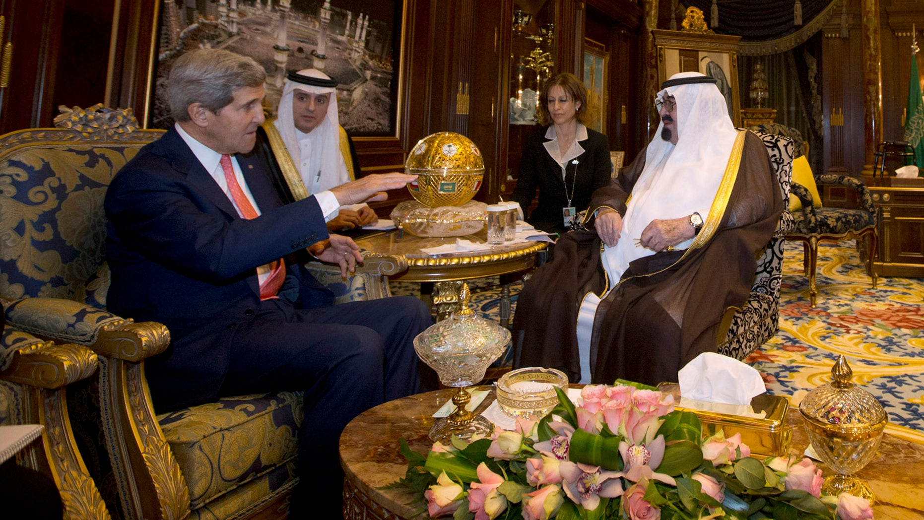 "U.S. Secretary of State John Kerry meets with Saudi Arabia's King Abdullah, right, in Riyadh, Monday, Nov. 4, 2013. Seeking to bridge multiple policy rifts with Saudi Arabia, Kerry hailed the kingdom's role as ""the senior player"" in the Middle East on Monday. Speaking to employees at the U.S. Embassy in Riyadh ahead of meetings with Saudi Arabia's king and foreign minister, Kerry said Saudi Arabia had assumed the Arab leadership mantle from Egypt, which is currently distracted by major domestic uncertainty. He said strengthening the U.S.-Saudi partnership is critical to Mideast security and stability and cementing tentative political transitions around the region. (AP Photo/Jason Reed, Pool)"