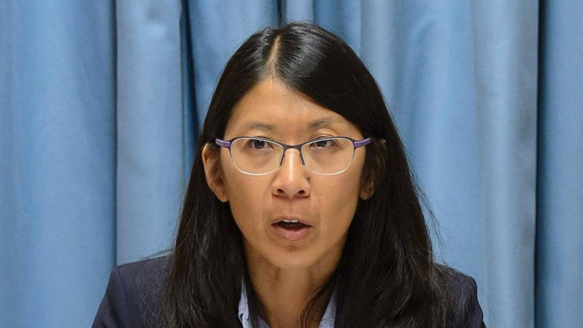 """Joanne Liu, President of Medecins Sans Frontieres, MSF, International, speaks during a news conference on the US air strike on a hospital in Kunduz, Afghanistan, in Geneva, Switzerland, Wednesday, Oct. 7, 2015. Liu, told reporters that the weekend strike """"was not just an attack on our hospital, it was an attack on the Geneva Conventions. This cannot be tolerated."""" (Martial Trezzini/Keystone via AP)"""