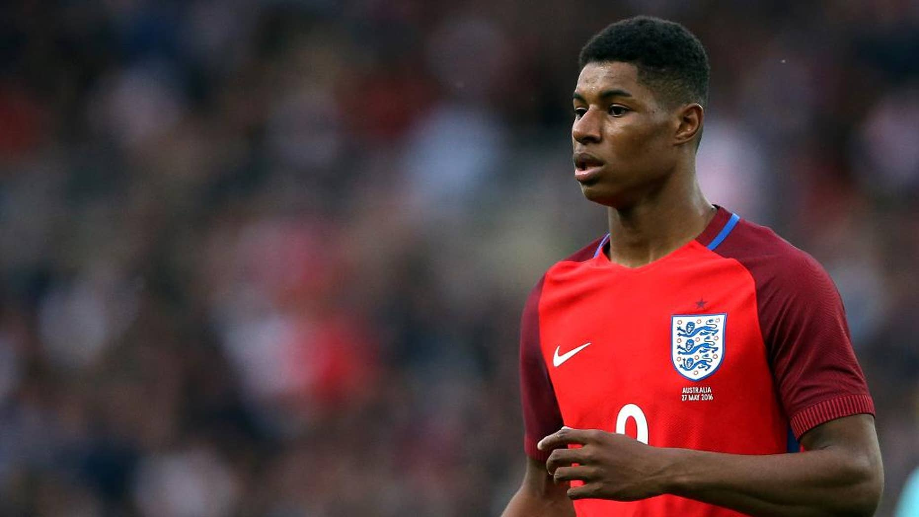 FILE - In this Friday, May 27, 2016 file photo, England's Marcus Rashford runs during the International friendly soccer match between England and Australia at the Stadium of Light, Sunderland, England. Marcus Rashford is going to the European Championship with England, barely three months after the 18-year-old striker made his senior debut with Manchester United. Rashford scored three minutes into his England debut in Friday's 2-1 win over Australia and he made the cut on Tuesday, May 31 for the final 23-man Euro 2016 squad.  (AP Photo/Scott Heppell, file)
