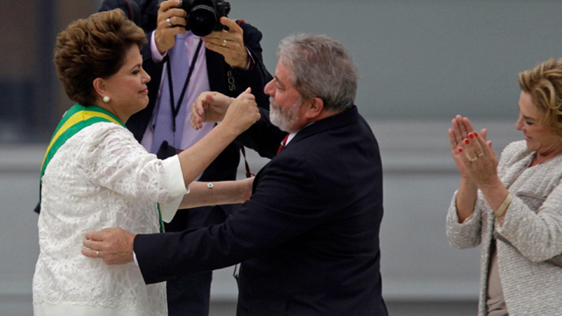 Jan. 1, 2011: Brazil´s outgoing President Luiz Inacio Lula da Silva embraces Brazil's President Dilma Rousseff after placing the presidential sash on her at the Planalto palace in Brasilia, Brazil