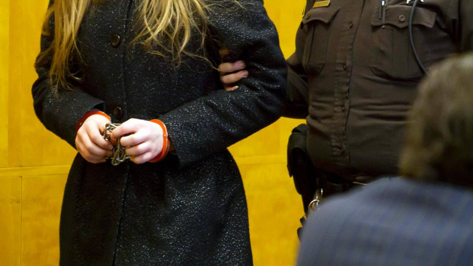 One of two 12-year-old girls accused of stabbing a classmate to please the fictional character Slender Man is led into a courtroom at the Waukesha County Courthouse in Waukesha, Wis. Tuesday, Nov. 18, 2014. Her attorney challenged a doctor's report that said she was competent to stand trial. A competency hearing was scheduled for Dec. 18, the same day as a competency hearing for the other girl accused in the case. (AP Photo/Waukesha Freeman, Charles Auer, Pool)