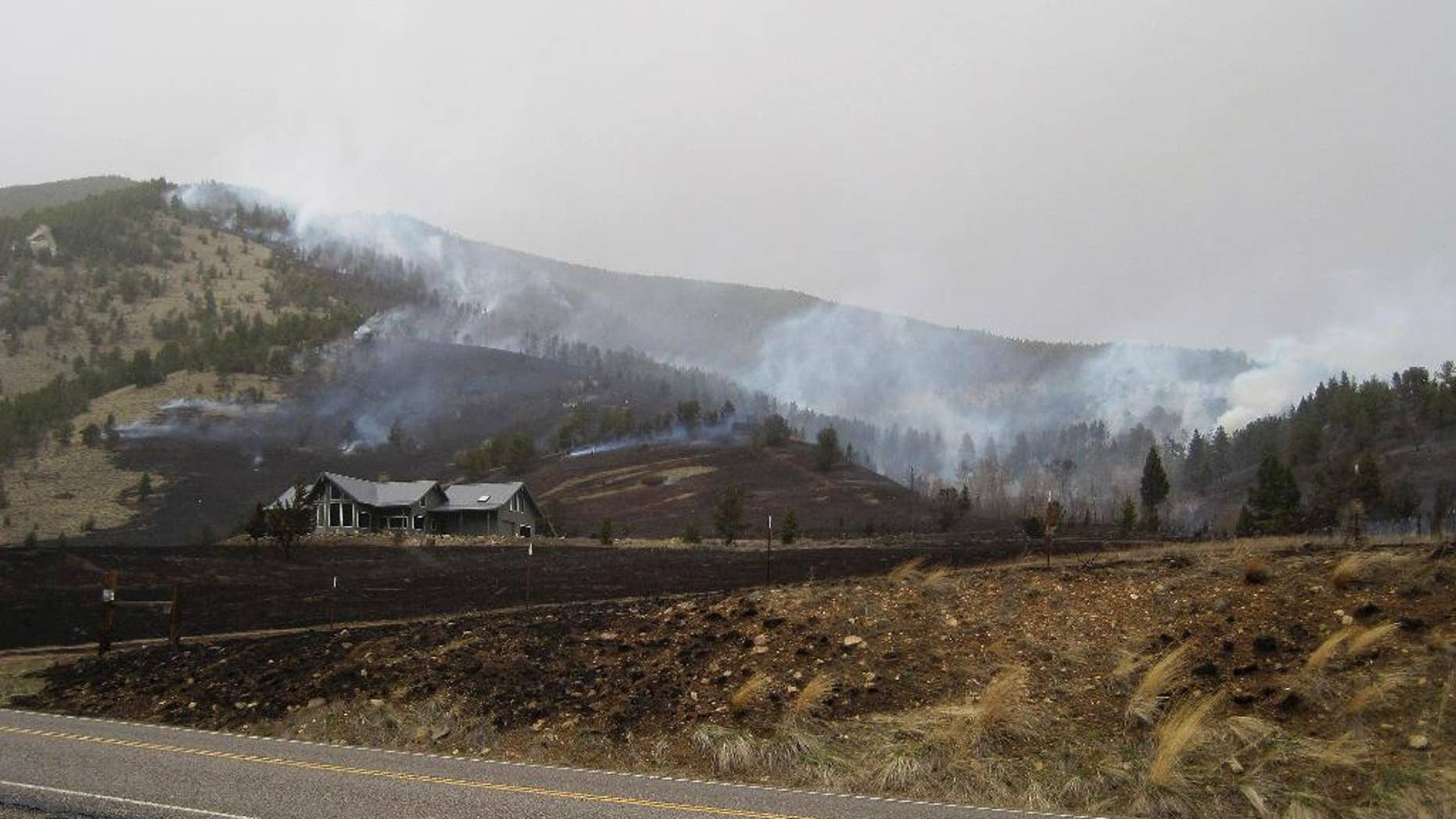 In this photo released by the U.S. Forest Service, the Wildland Fire burns along Nichols Creek Saturday, March 28, 2015, near Red Lodge, Montana. Authorities evacuated a ski lodge in southern Montana because of a wind-driven wildfire heading toward it. The wildfire was reported about 1:45 p.m. Saturday and had burned an estimated 200 acres of grass and timber about 4 miles west of the community of Red Lodge. The fire began on open private land, but it was driven by winds gusting 35 to 50 mph into the Custer National Forest, where the Red Lodge Mountain Resort ski area is located. (AP Photo/U.S. Forest Service)