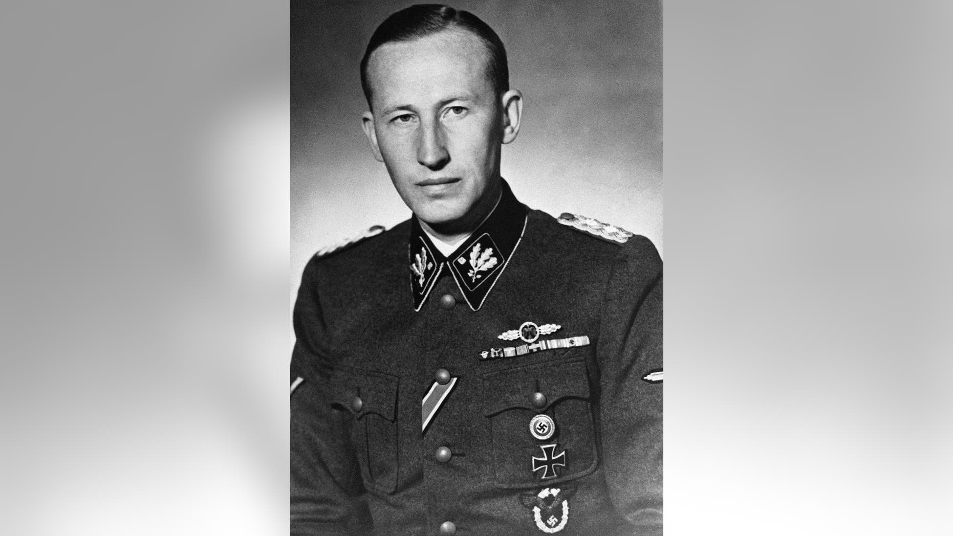 """FILE - The 1942 file photo shows Nazi leader Reinhard Heydrich in an unknown location sometime in 1942.  Lina Heydrich, the widow of assassinated Heydrich, one of the main architects of the Holocaust, was among the most prominent recipients of pensions for """"victims of war"""" who were injured in World War II.  (AP Photo)"""