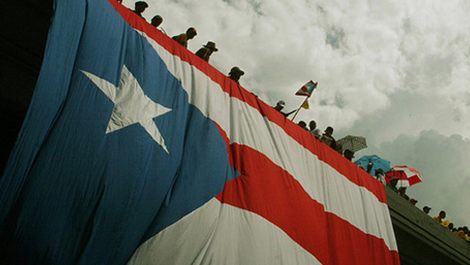 (October 15th, 2009) Thousands of protestors flooded the streets in the largest public gathering in Puerto Rican history.  The massive strike was in response to the republican governor Luis Fortu–o's decision to lay off 16,720 public workers.  ~ San Juan, Puerto Rico ~ Photo © 2009 Ricardo Figueroa