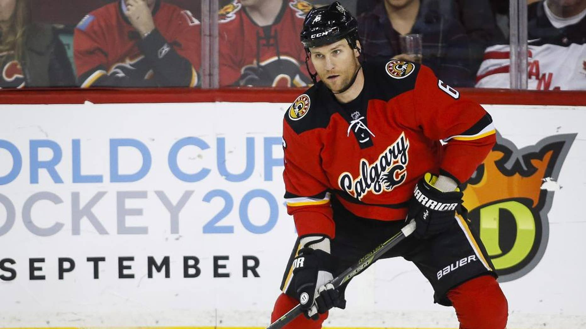 File-This March 11, 2016, file photo shows Calgary Flames' Dennis Wideman handling the puck during the first period of an NHL hockey game against the Arizona Coyotes,in Calgary, Alberta. The national Hockey League asked a Manhattan federal court judge Wednesday, June 8, 2016, to reject the reduction of Calgary Flames defenseman Dennis Wideman's suspension for knocking down a linesman. An independent arbitrator reduced Wideman's suspension from 20 games to 10 after ruling that Wideman did not intend to injure linesman Don Henderson in Jan. 27 game against the Nashville Predators. The suspension has already been served. (Jeff McIntosh/The Canadian Press via AP) MANDATORY CREDIT