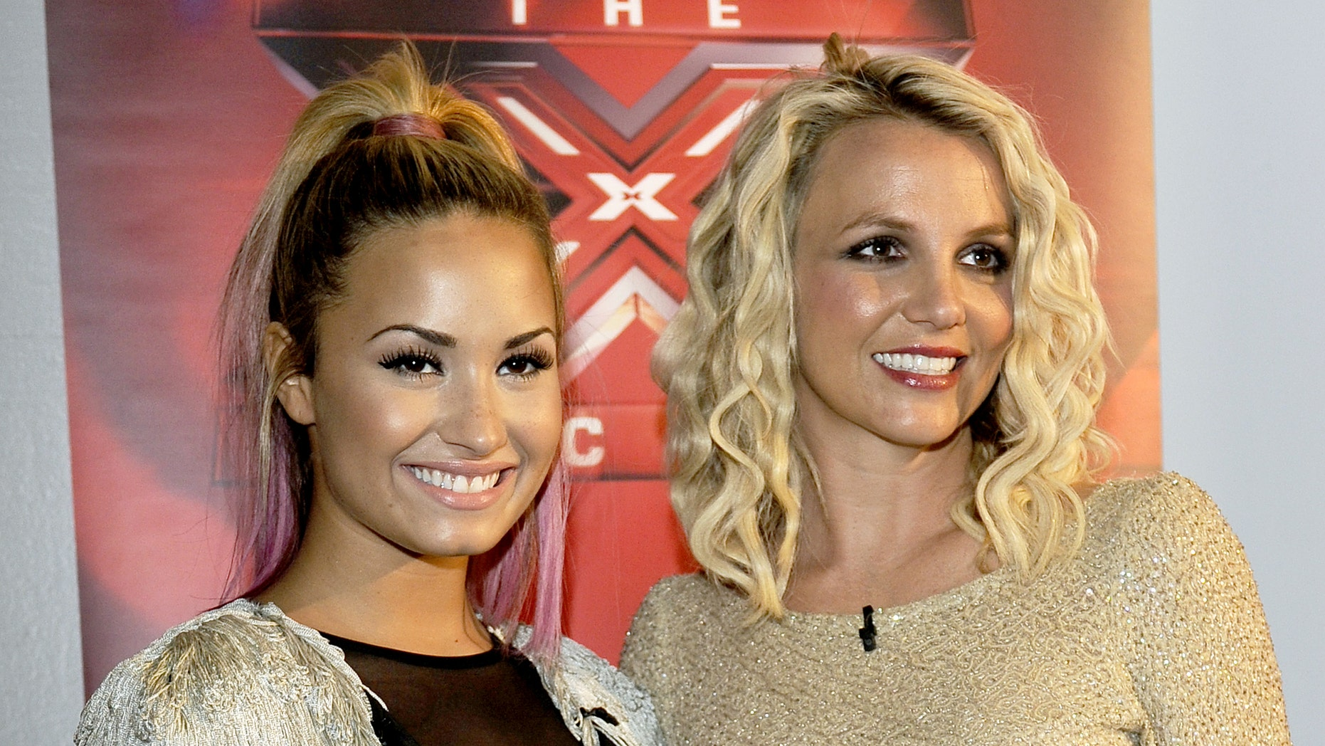 """OAKLAND, CA - JUNE 16: Demi Lovato (L) and Britney Spears attend Fox's """"The X Factor"""" Season 2 Auditions at Oracle Arena on June 16, 2012 in Oakland, California. (Photo by Tim Mosenfelder/Getty Images)"""