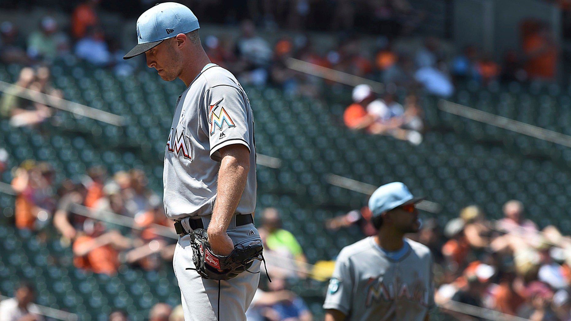 Miami Marlins pitcher Trevor Richards pauses before leaving a baseball game against the Baltimore Orioles' in the fourth inning Sunday, June 17, 2018, in Baltimore.
