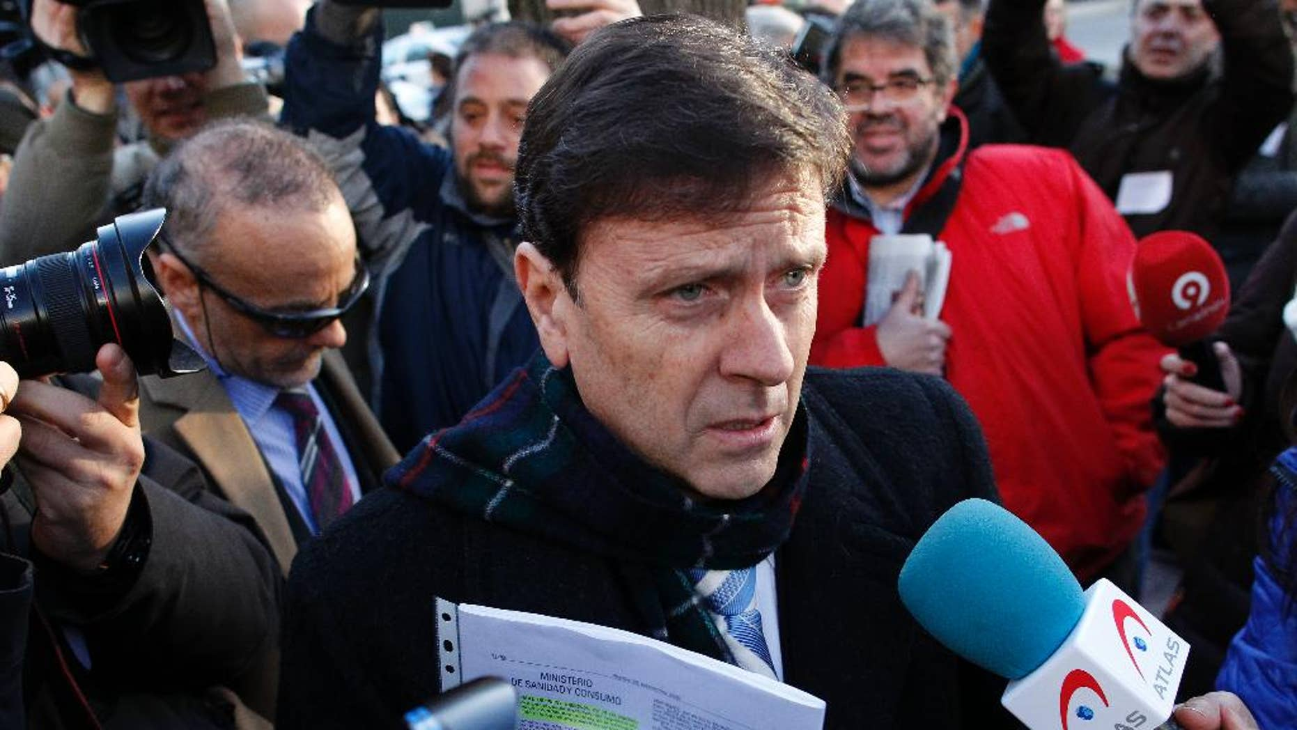 FILE - In this Monday, Jan. 28, 2013 file photo, Doctor Eufemiano Fuentes arrives at a court house in Madrid, Spain.  A court was set to rule Tuesday June 14, 2016, on whether hundreds of blood bags that are key evidence in one of Spain's worst doping scandals should be destroyed or handed over to authorities for investigation. (AP Photo/Andres Kudacki, File)