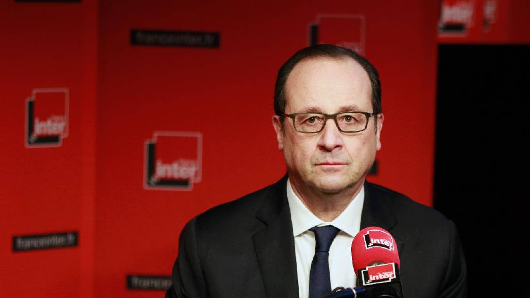 French President Francois Hollande prepares to answer a reporter's question during a live interview on French radio station France Inter in Paris Monday, Jan. 5, 2015. (AP Photo/Remy de la Mauviniere/Pool)