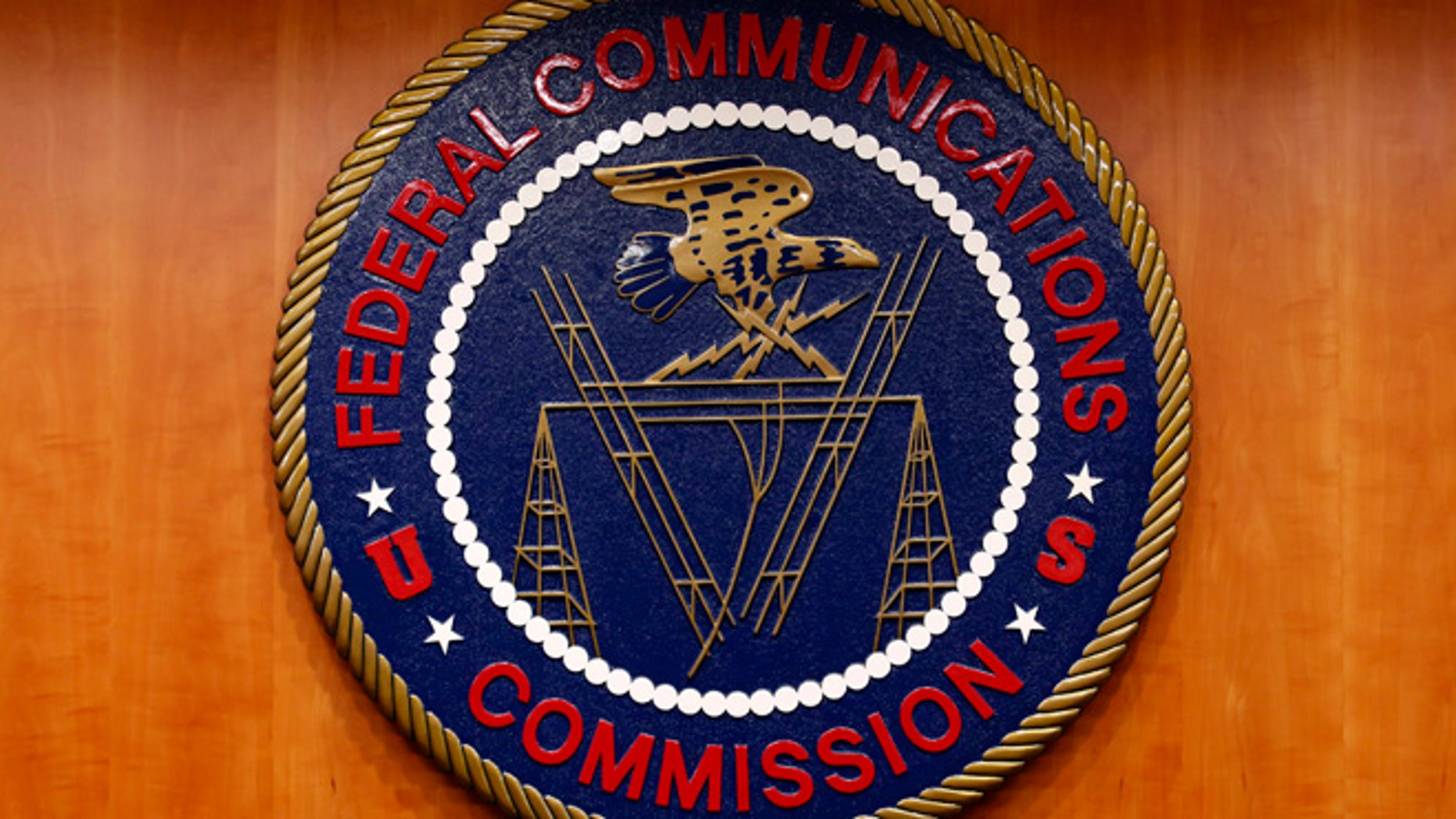 Feb. 26, 2015: The Federal Communications Commission (FCC) logo is seen before a net neutrality hearing in Washington.