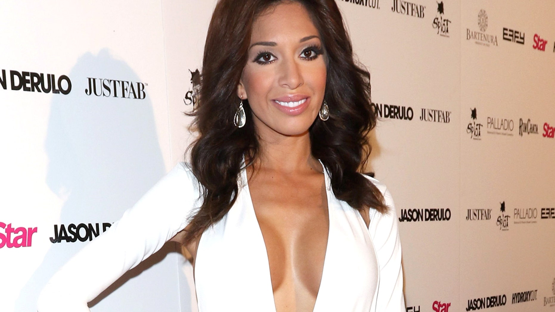 Farrah Abraham typically wears more revealing looks such as this white dress with a plunging neckline.