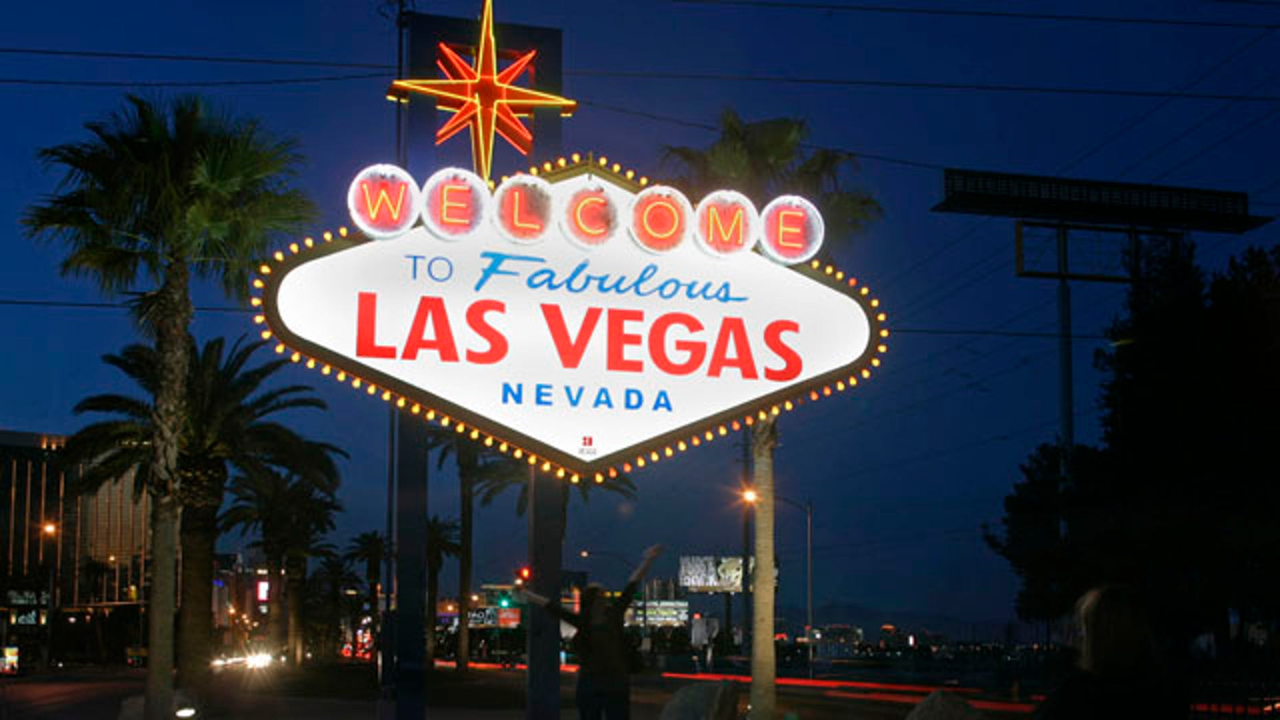 A view of the 'Welcome To Fabulous Las Vegas' neon sign is seen before Earth Hour in Las Vegas, Nevada, March 27, 2010. Countries around the world have signed up for Earth Hour on Saturday in which homes, office towers and landmarks will turn off their lights from 8.30 pm local time to raise awareness about climate change and the threat from rising greenhouse gas emissions.  