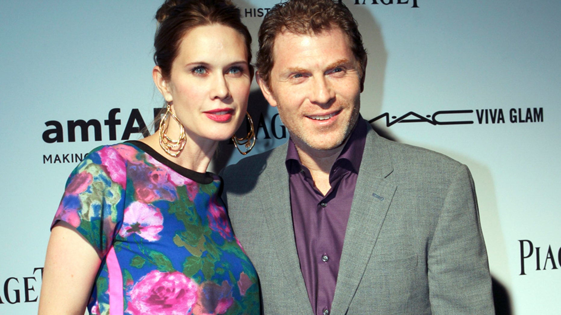 Actress Stephanie March and her husband, chef Bobby Flay, attend the amfAR Inspiration Miami Beach Party at Soho Beach House in Miami Beach, Florida December 6, 2012.