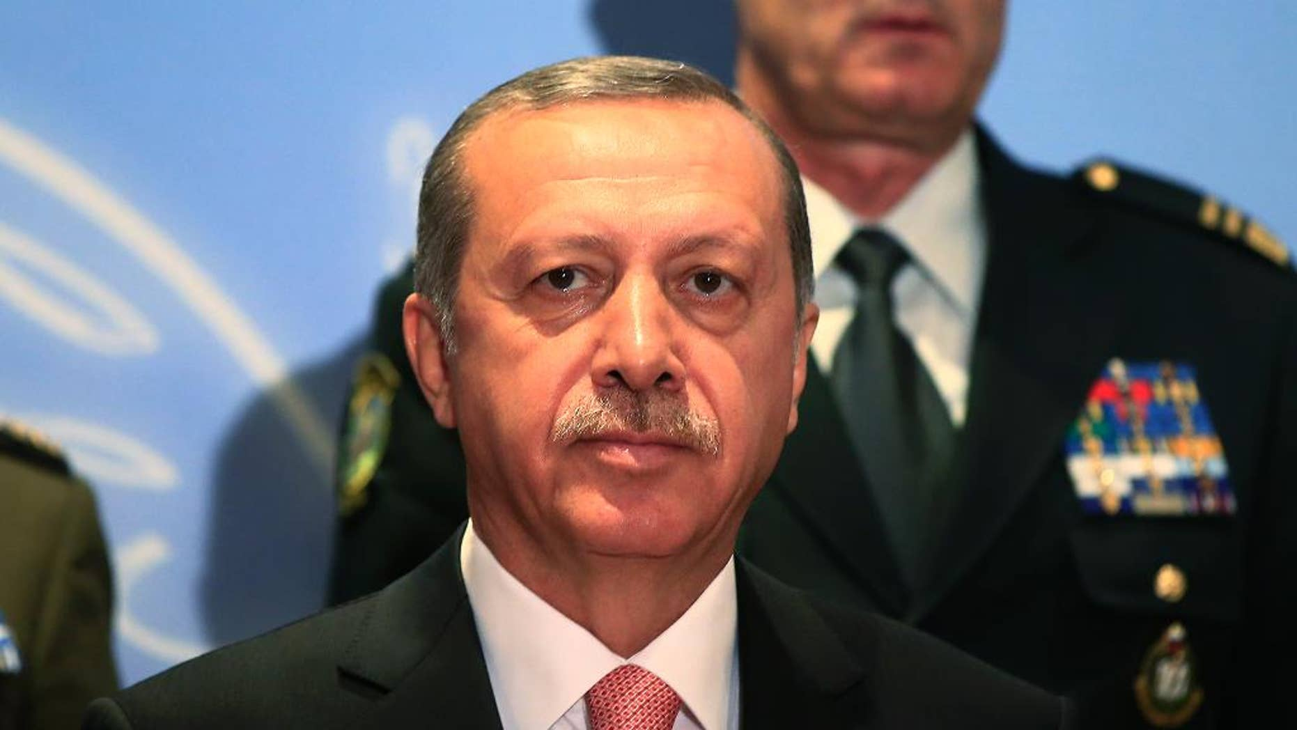 Turkey's President Recep Tayyip Erdogan, poses for photographs with military chiefs of Balkan nations following his speech at their conference, in Istanbul Wednesday, May 11, 2016. Erdogan said Turkish forces have killed some 3,000 Islamic State militants in Syria and Iraq, insisting that no other country has matched Turkey's efforts against the extremist group. At the same meeting earlier however, the Turkish military chief, put the number of IS militants killed Syria and Iraq at 1,300. (AP Photo/Lefteris Pitarakis)