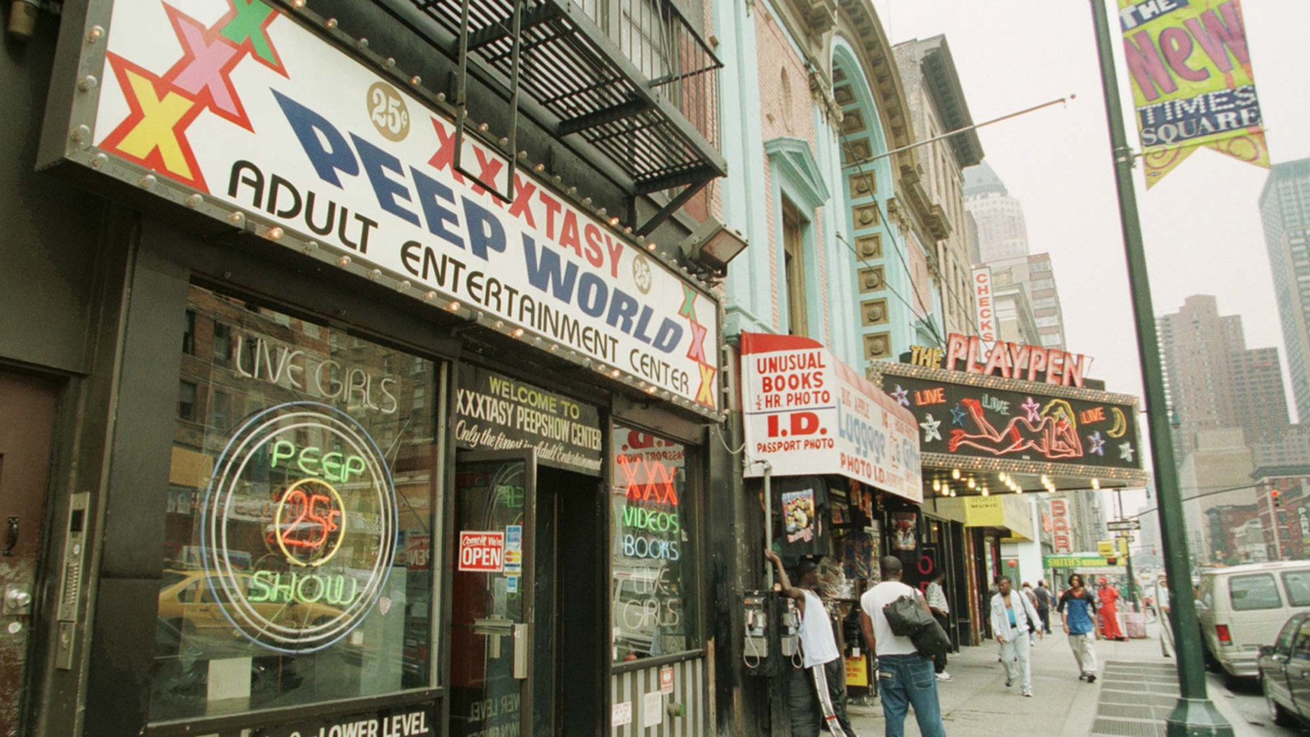 FILE 1998: Strip clubs and pornography shops  near Times Square in New York.