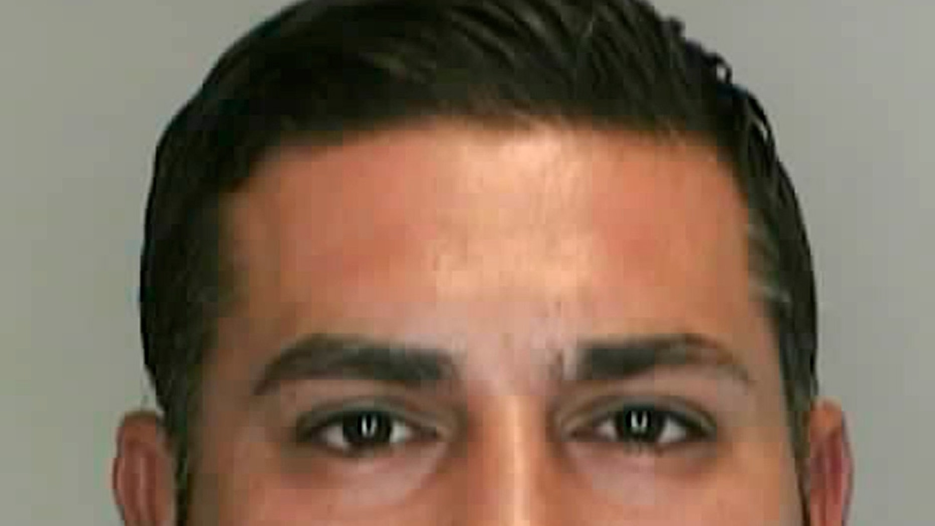 FILE- In this file photo provided by the Livonia, Mich., Police Department is Baseel Abdul-Amir Saad, 37. Saad was sentenced to at least eight years in prison for a punch that killed soccer referee John Bieniewicz during a game last summer. Bieniewicz' wife filed a $51 million lawsuit Friday, April 3, 2014 against Saad. (AP Photo/Livonia Police Department, File)