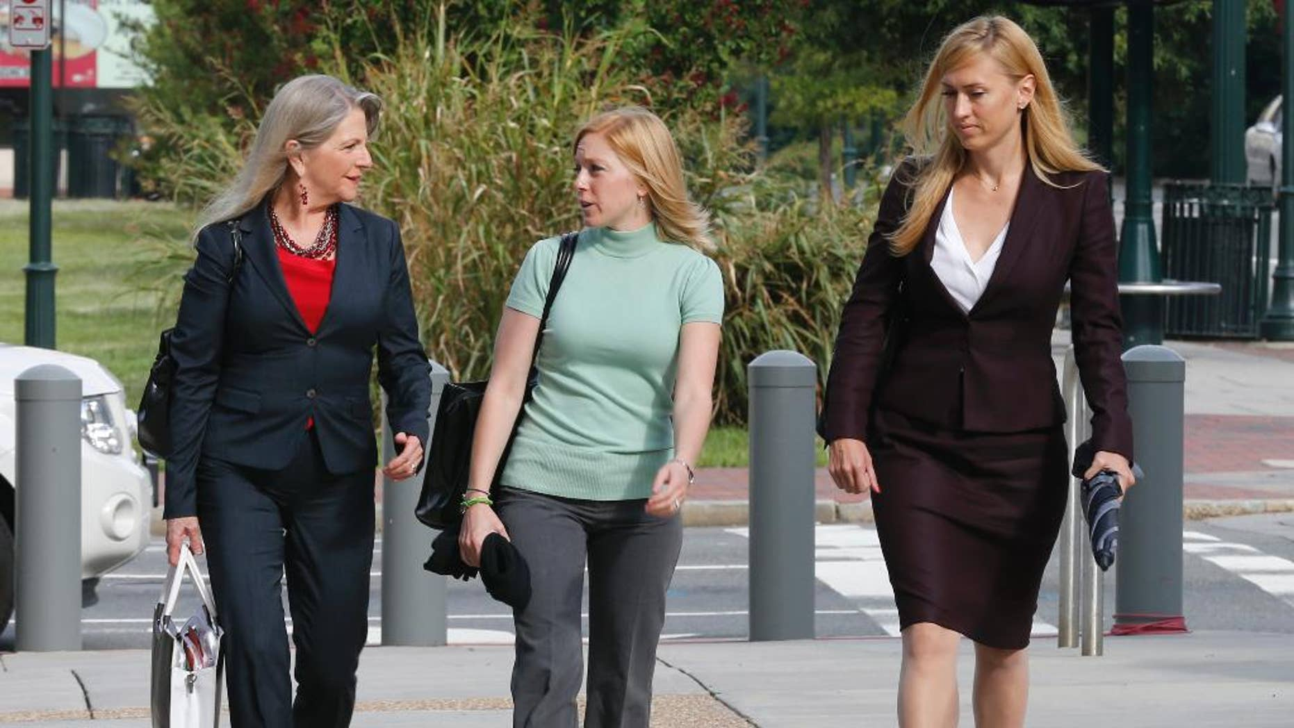 Former Virginia first lady, Maureen McDonnell, left, talks with her Daughter Cailin Young, center, and her attorney Heather Martin, as they arrive at federal court in Richmond, Va., Tuesday, Aug. 19, 2014. The McDonnells are presenting the second day of his defense on corruption charges. (AP Photo/Steve Helber)