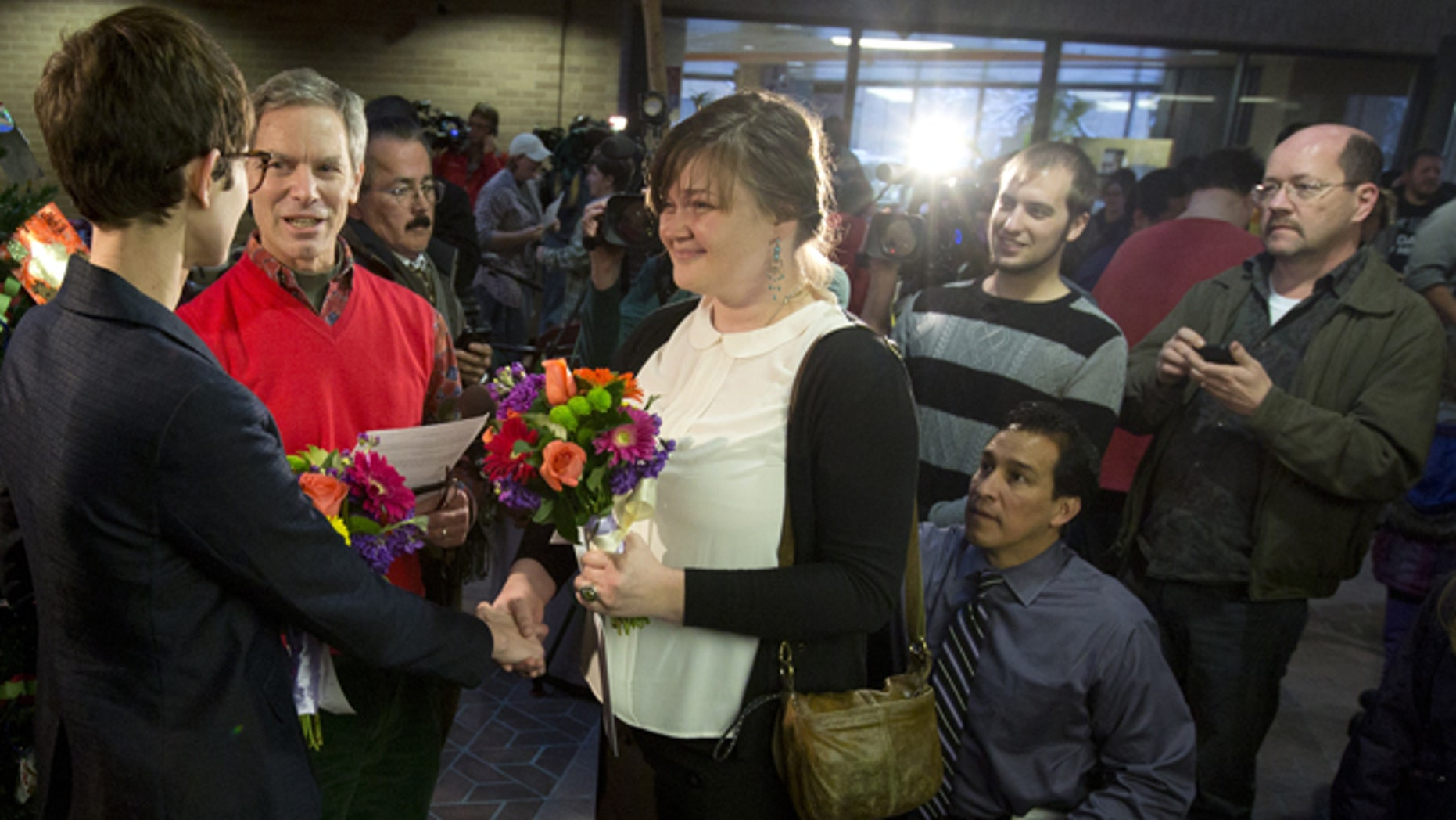 Dec. 20, 2013: Natalie Dicou, left, and Nicole Christensen, right, are married by Salt Lake City Mayor Ralph Becker, middle, in the lobby of the Salt Lake County Clerk's Office in Salt Lake City.