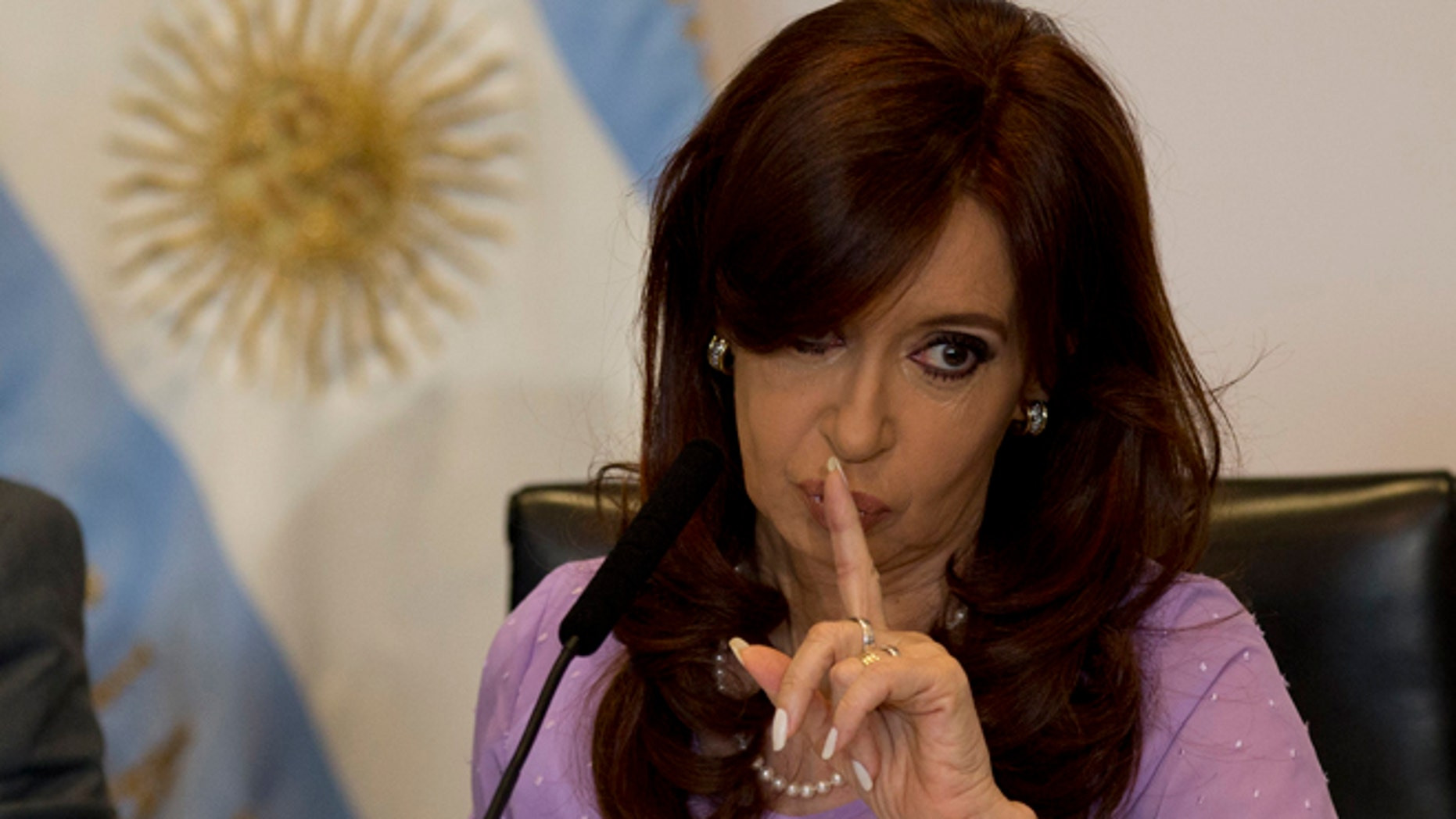 Then-President Cristina Fernandez of Argentina signals to supporters during an event in Buenos Aires, Feb. 11, 2015.