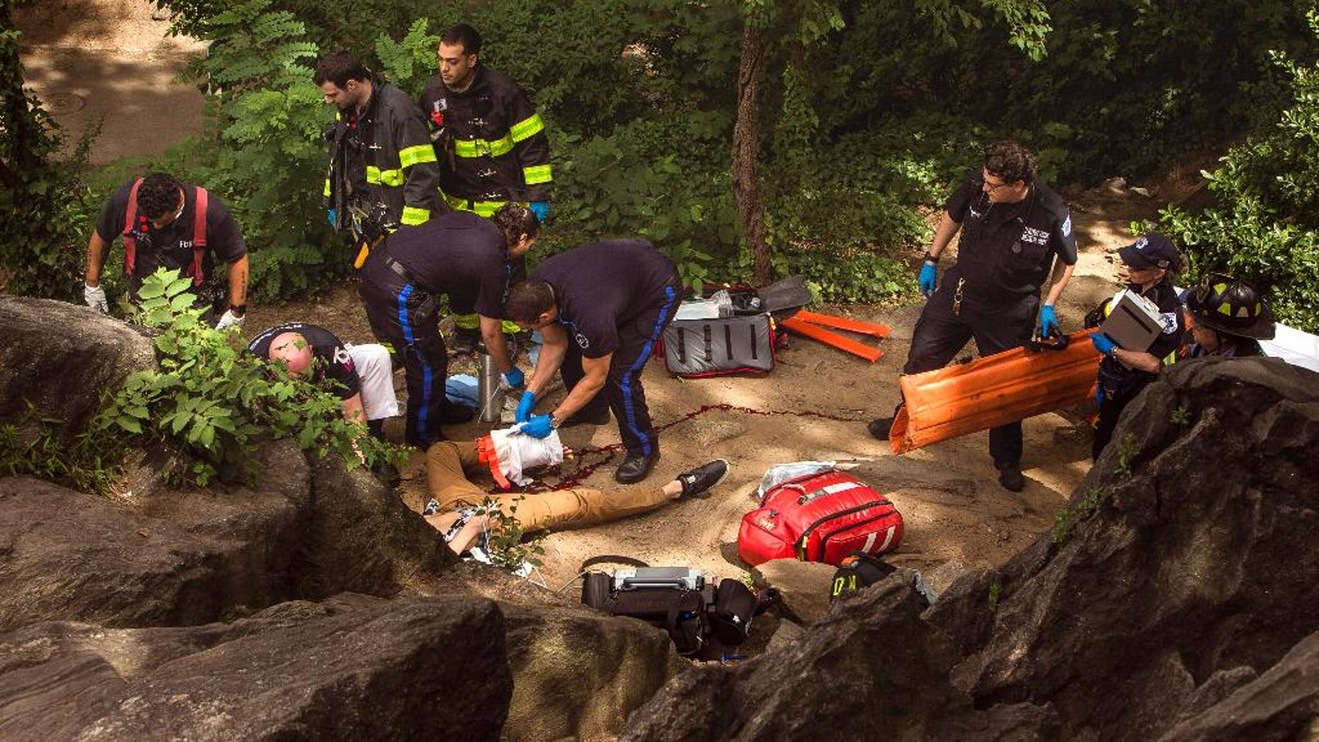FILE - In this July 3, 2016 file photo, Connor Golden, first responders tend to Connor Golden, a teenage tourist from Virginia, after he was injured in an explosion in Central Park.