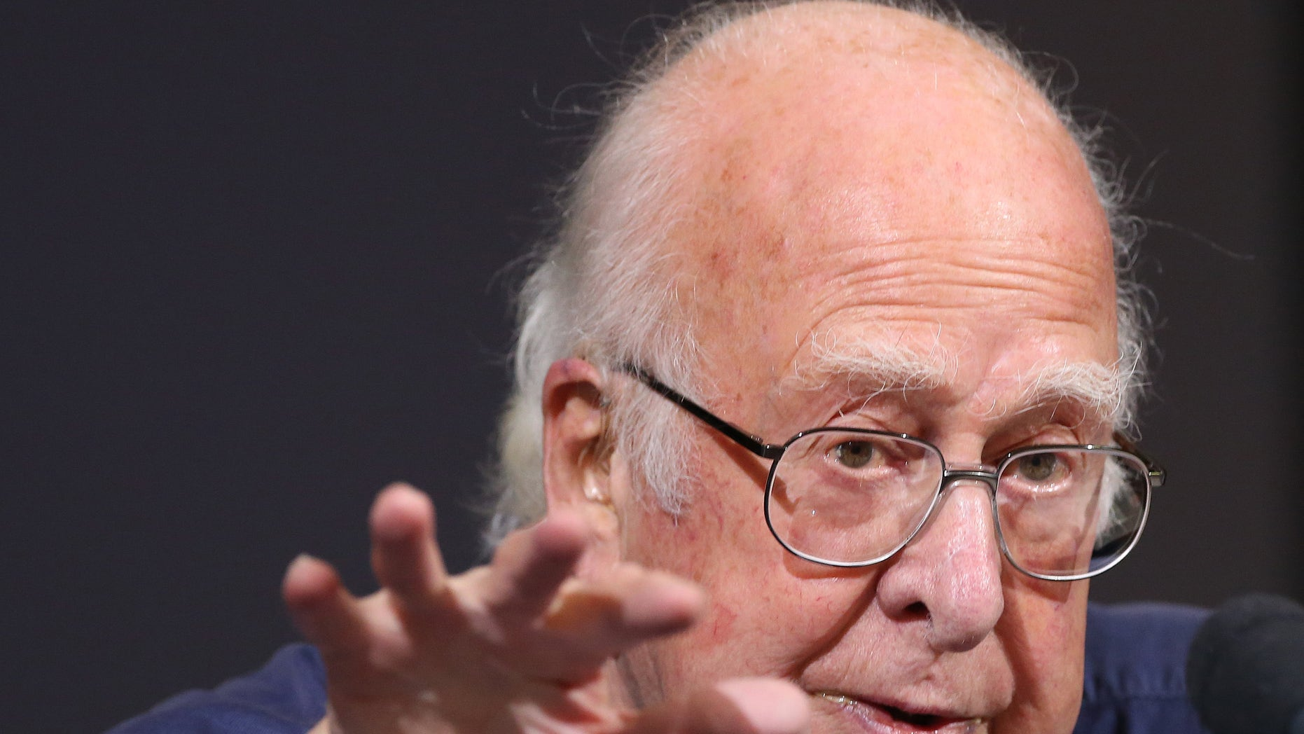 Oct. 11, 2013: Britain's Professor Peter Higgs gestures during a press conference in Edinburgh, Scotland in this file photo.