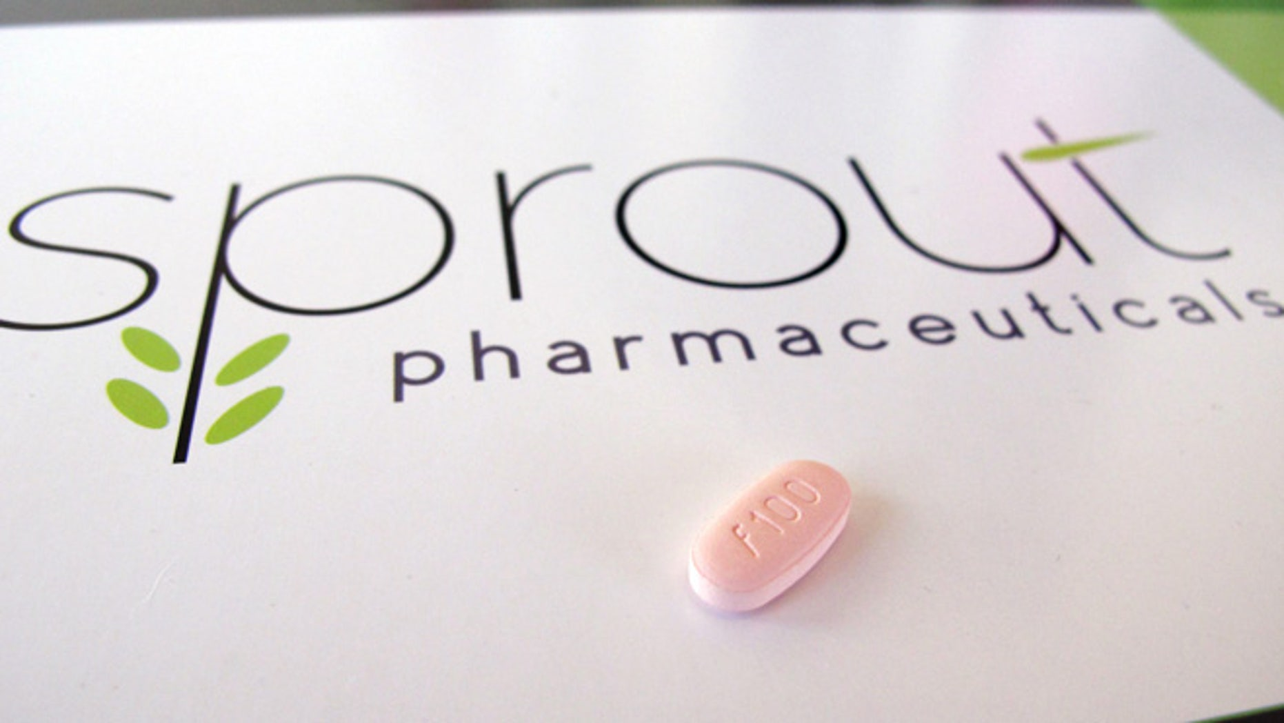 In this June 22, 2015, photo, a tablet of flibanserin sits on a brochure for Sprout Pharmaceuticals in the company's Raleigh, N.C., headquarters. Sprout soon may succeed where many of the world''s largest pharmaceutical companies have failed: in winning Food and Drug Administration (FDA) approval for flibanserin, dubbed Addyi, the first drug to boost women''s sexual desire.