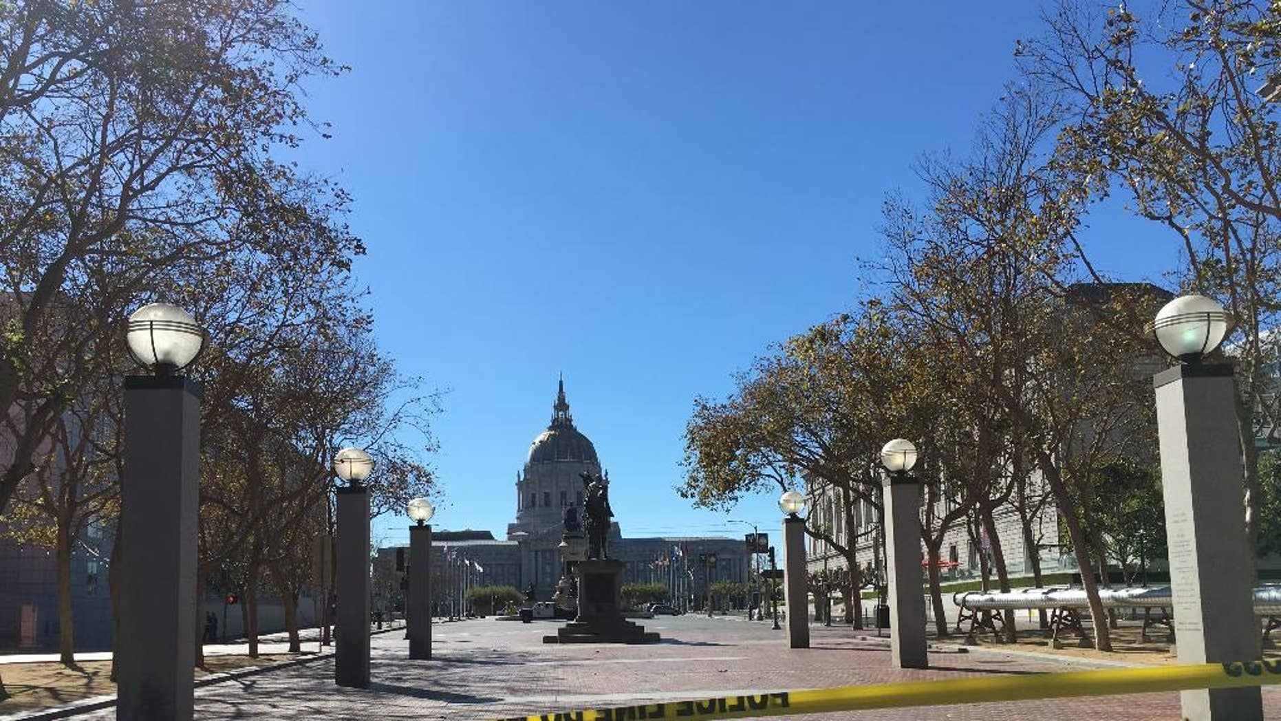 Police in San Francisco have blocked off traffic around Civic Center and United Nations Plaza after receiving reports of a man who might be armed, Saturday, Sept. 24, 2016. KGO-TV said Saturday that pedestrians and motorists are being asked to leave the area amid reports of a man holding up something that may be a weapon.