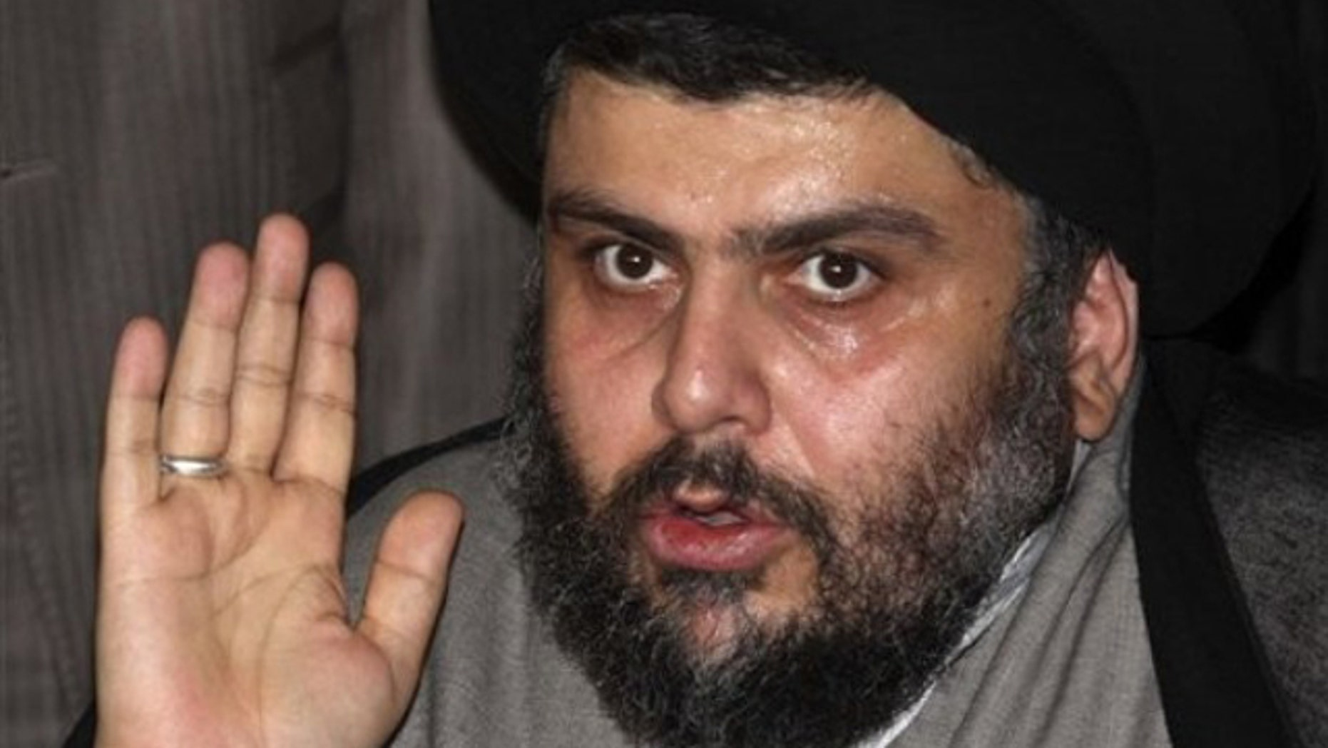 July 19: Muqtada al-Sadr, one of Iraq's most powerful Shiite political clerics, speaks to reporters following a meeting with former Iraqi Prime Minister Ayad Allawi in Damascus, Syria.