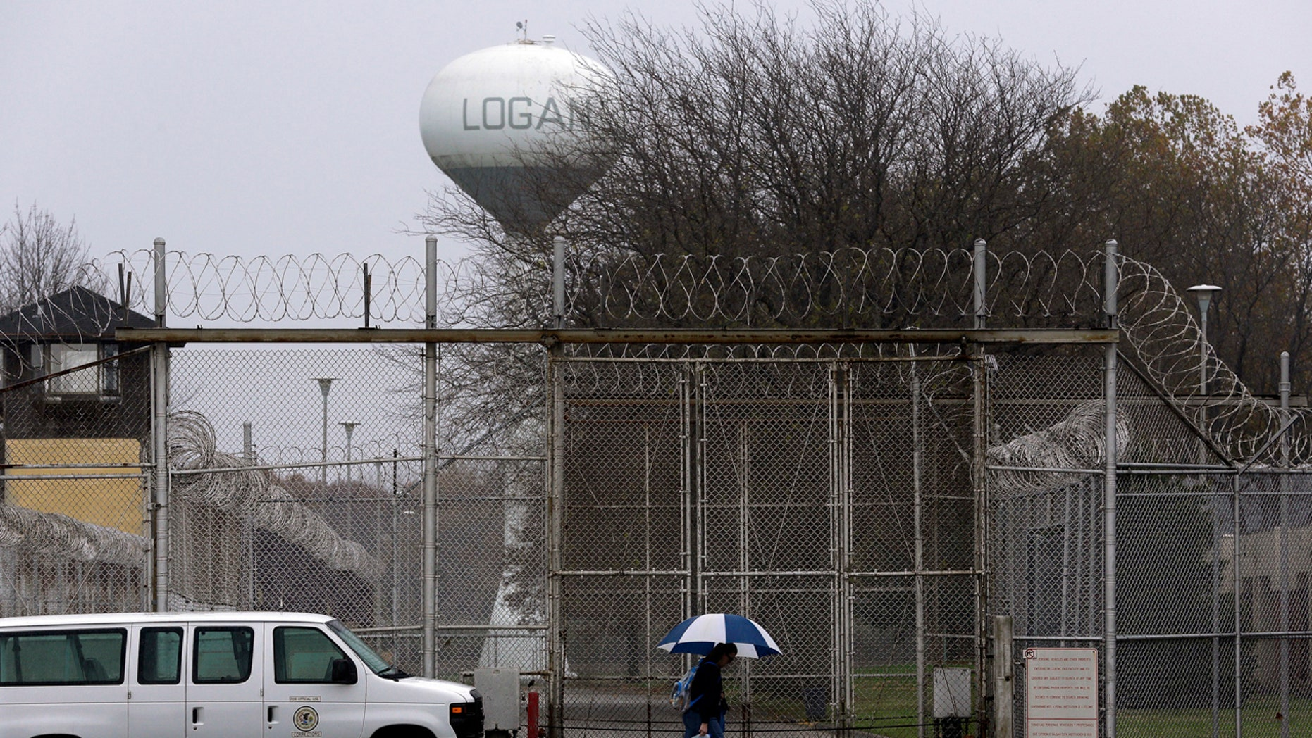 "Security fences surround the Logan Correctional Center Friday, Nov. 18, 2016, in Lincoln, Ill. Inmates at Illinois' main prison for women are demeaned as ""crazy"" and ""worthless"" by staff in a facility that offers little help to prepare women to re-enter the community, a study to be released Friday found."