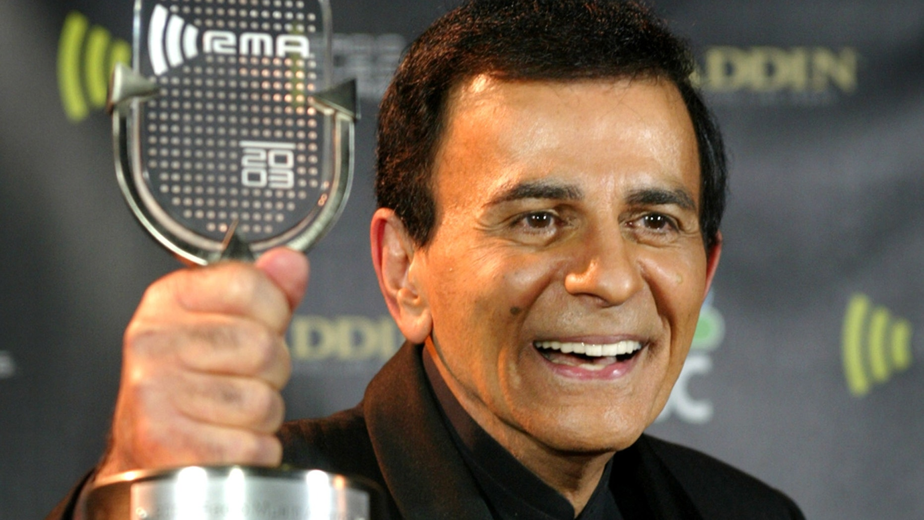 Casey Kasem poses with his Radio Icon Award at the 2003 Radio Music Awards, at the Aladdin Theatre for the Performing Arts in Las Vegas, Nevada, October 27, 2003.