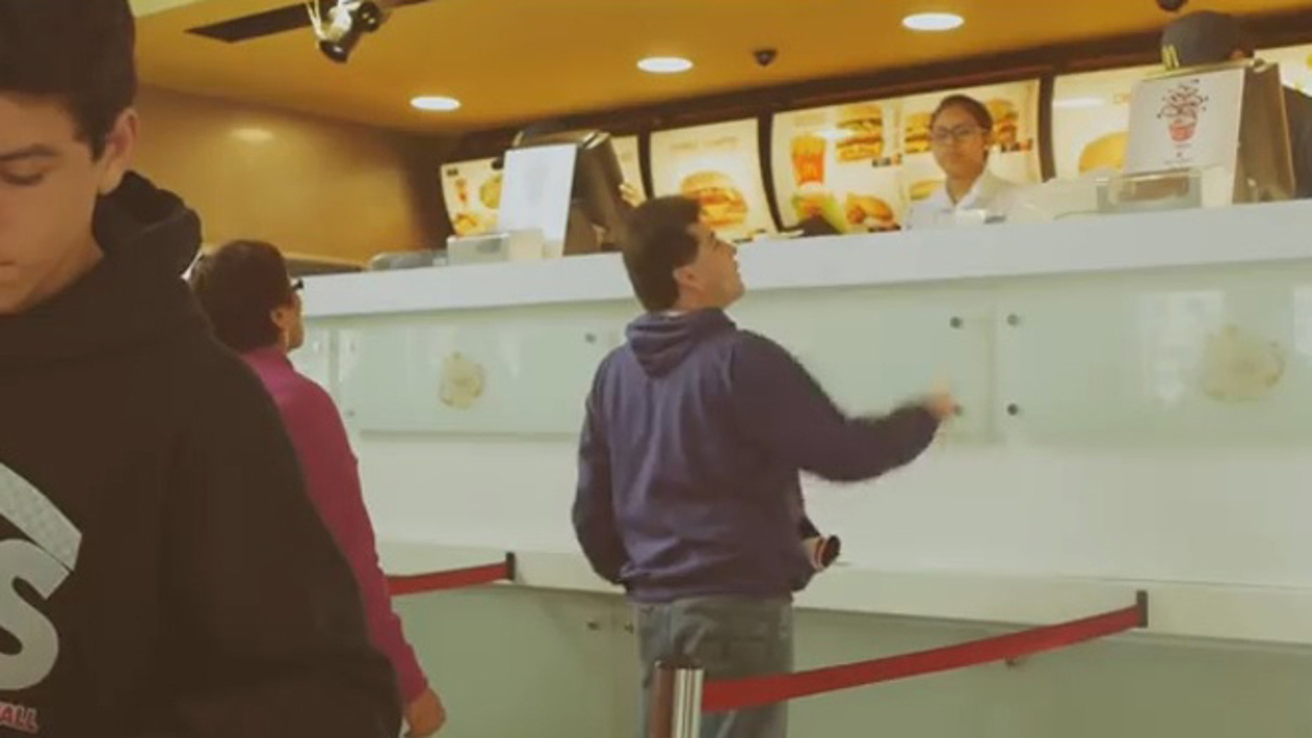 A customer peers above the larger than life counter.