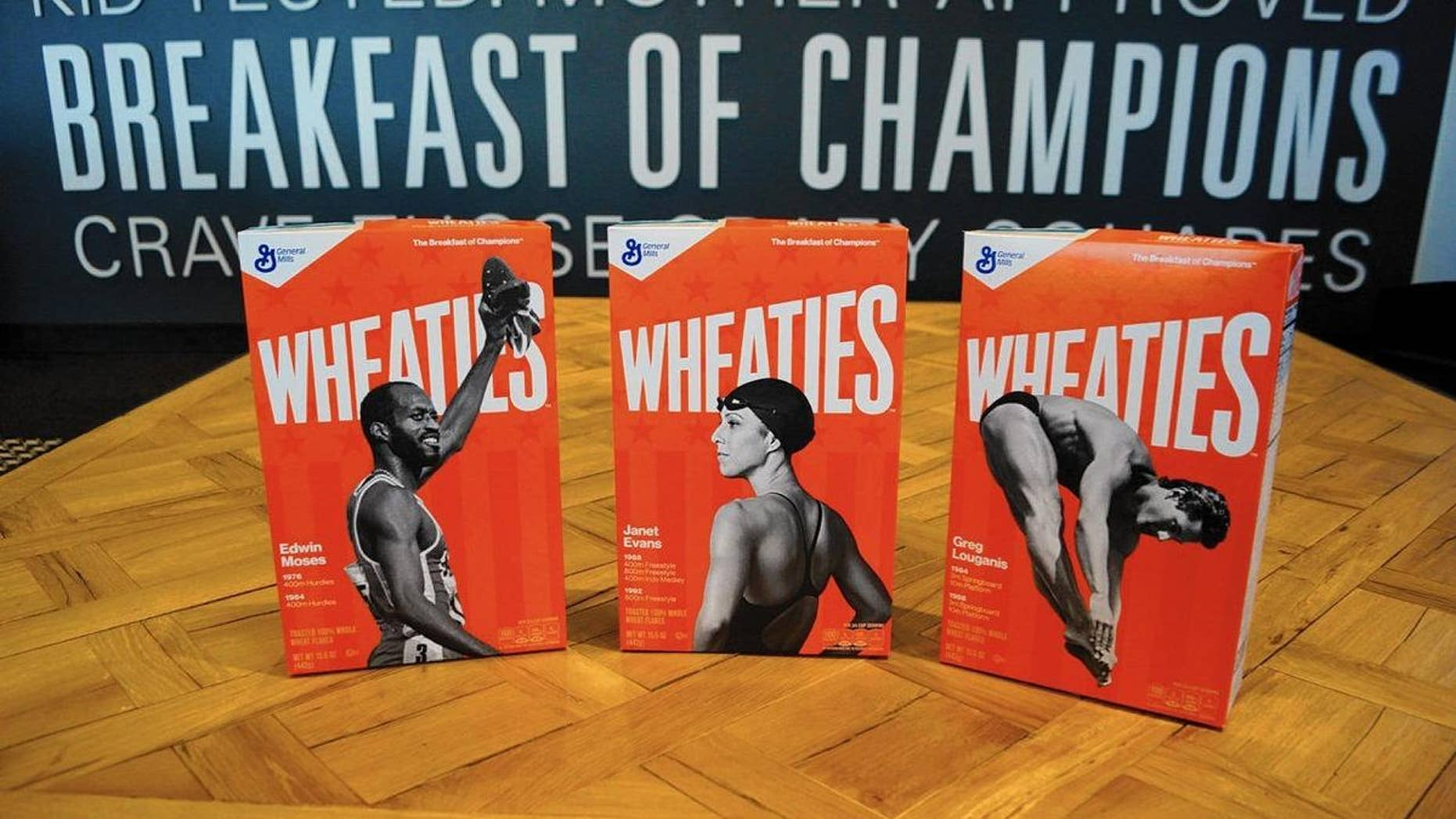 Edwin Moses, left, Janet Evans and Greg Louganis will appear on Wheaties boxes starting in May.