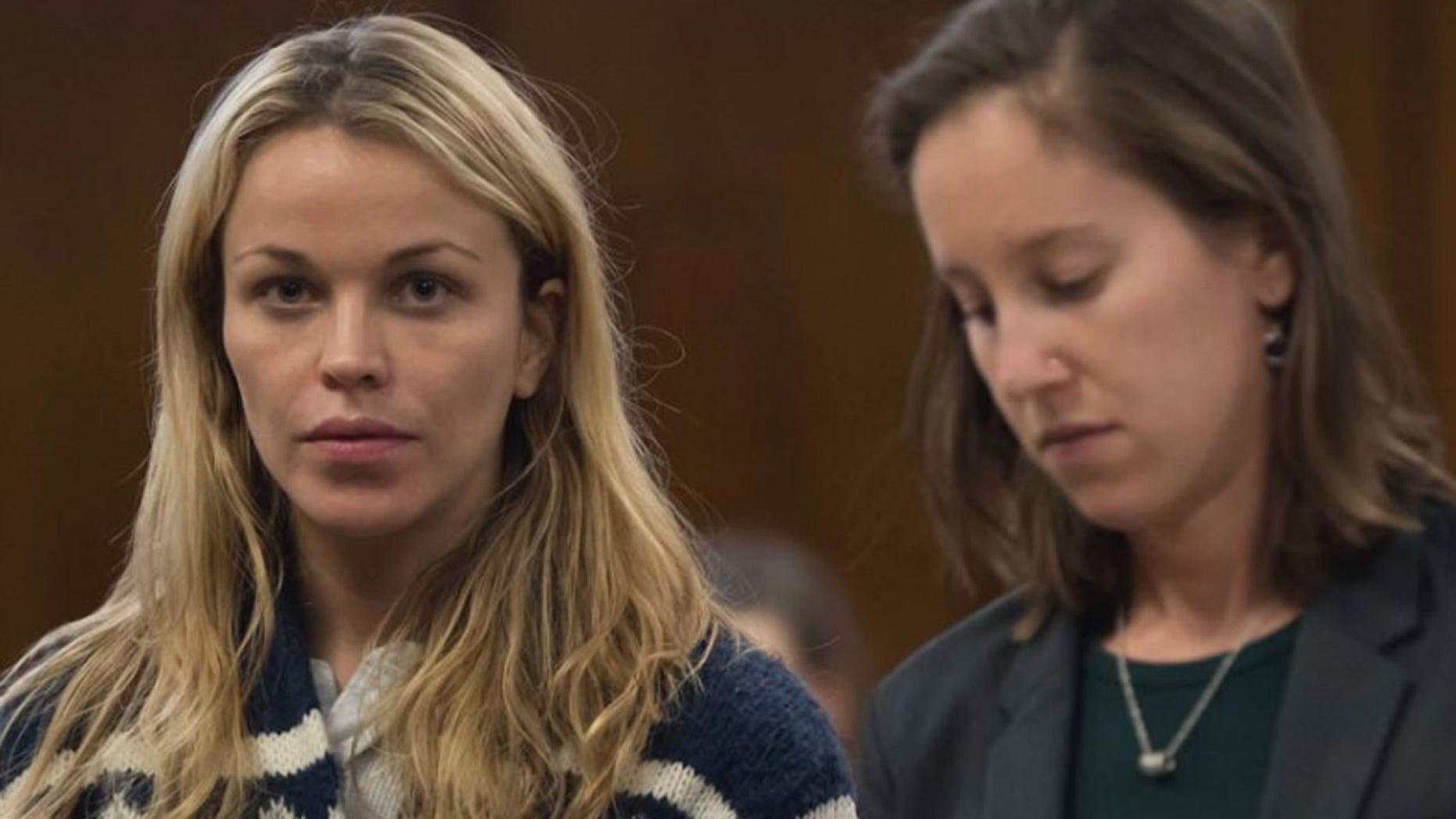 Jacqueline Kent Cooke, on the left, is arraigned in Manhattan Criminal Court.